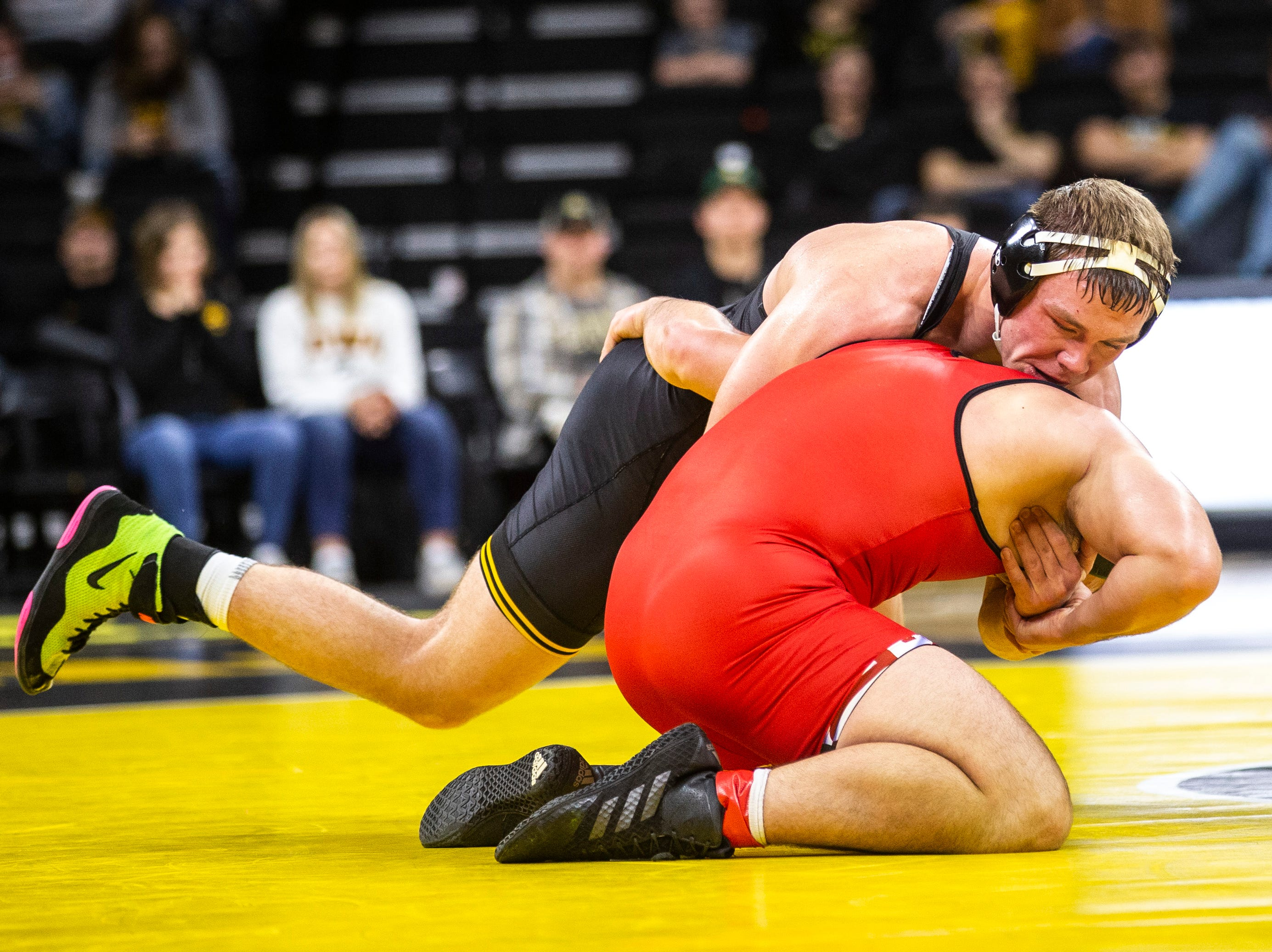 Iowa's Jacob Warner, left, wrestles Maryland's Niko Cappello at 197 during a NCAA Big Ten Conference wrestling dual on Friday, Feb. 8, 2019 at Carver-Hawkeye Arena in Iowa City, Iowa.