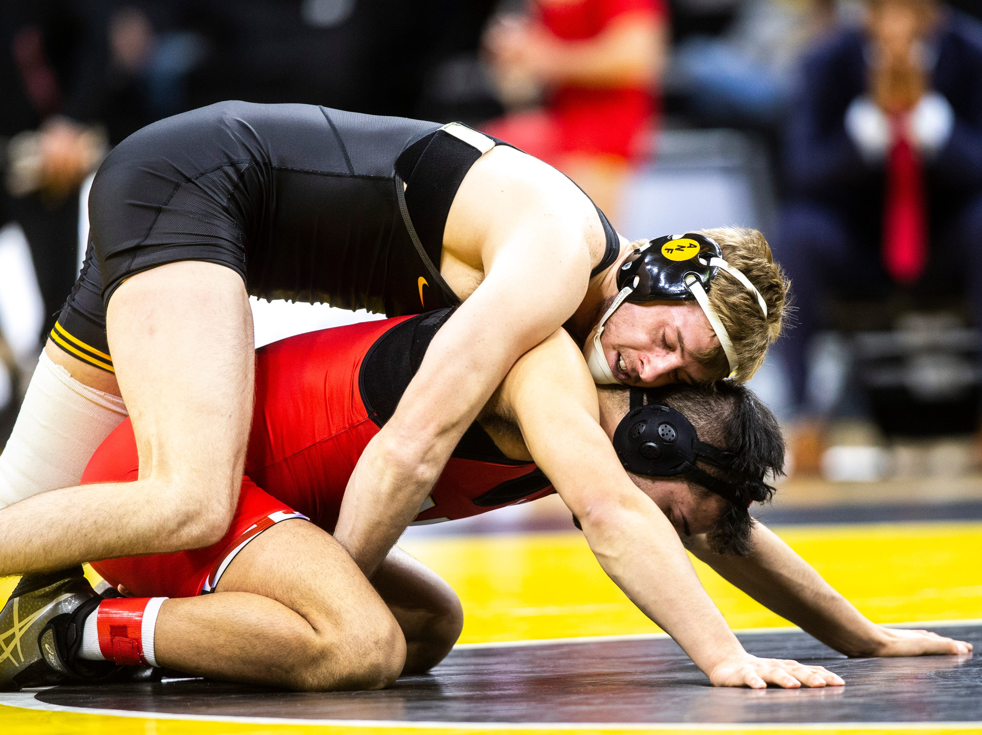 Iowa's Mitch Bowman, left, wrestles Maryland's Josh Uglade at 174 during a NCAA Big Ten Conference wrestling dual on Friday, Feb. 8, 2019 at Carver-Hawkeye Arena in Iowa City, Iowa.