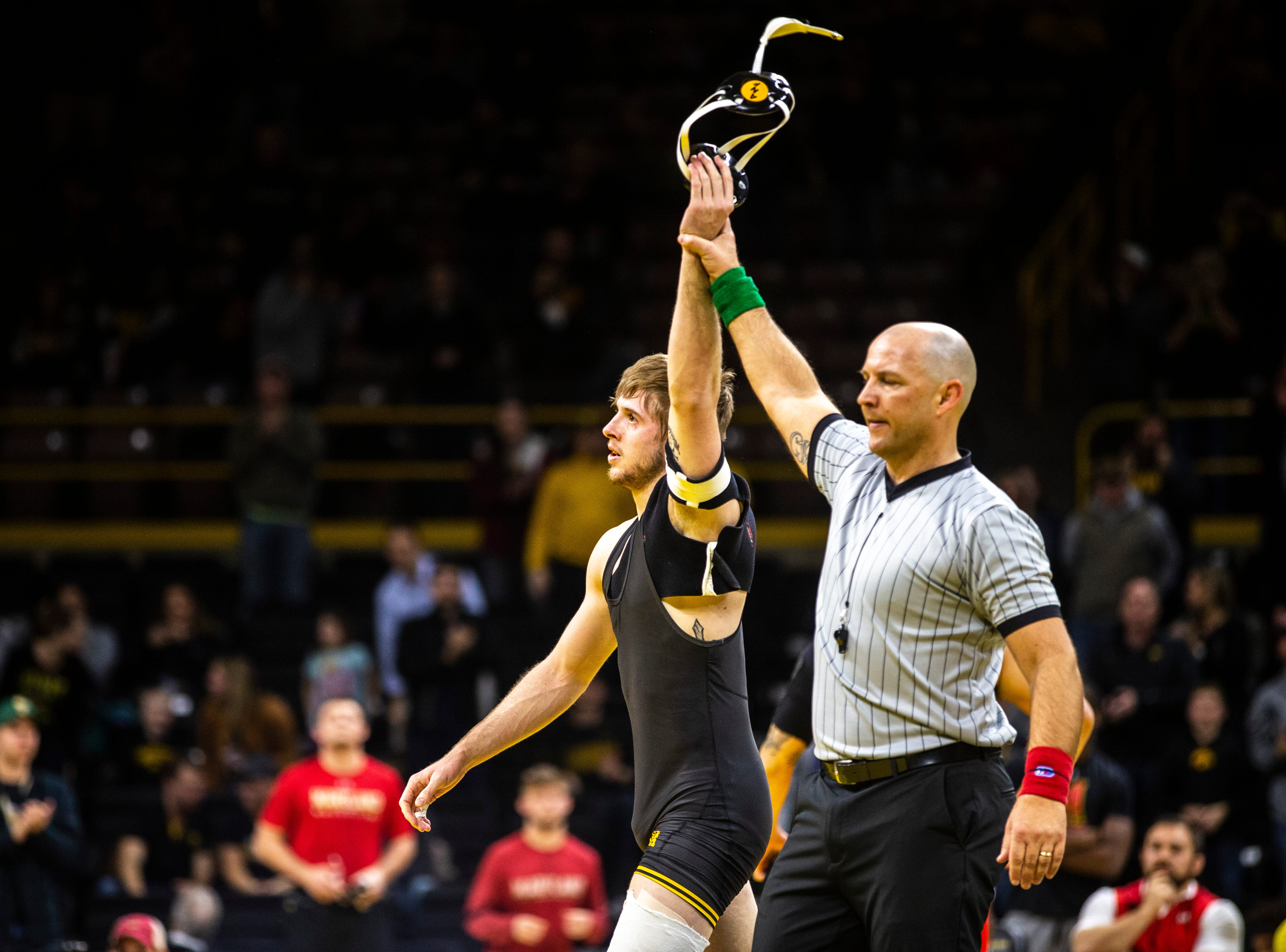 Iowa's Mitch Bowman has his hand raised after pinning Maryland's Josh Uglade at 174 during a NCAA Big Ten Conference wrestling dual on Friday, Feb. 8, 2019 at Carver-Hawkeye Arena in Iowa City, Iowa.