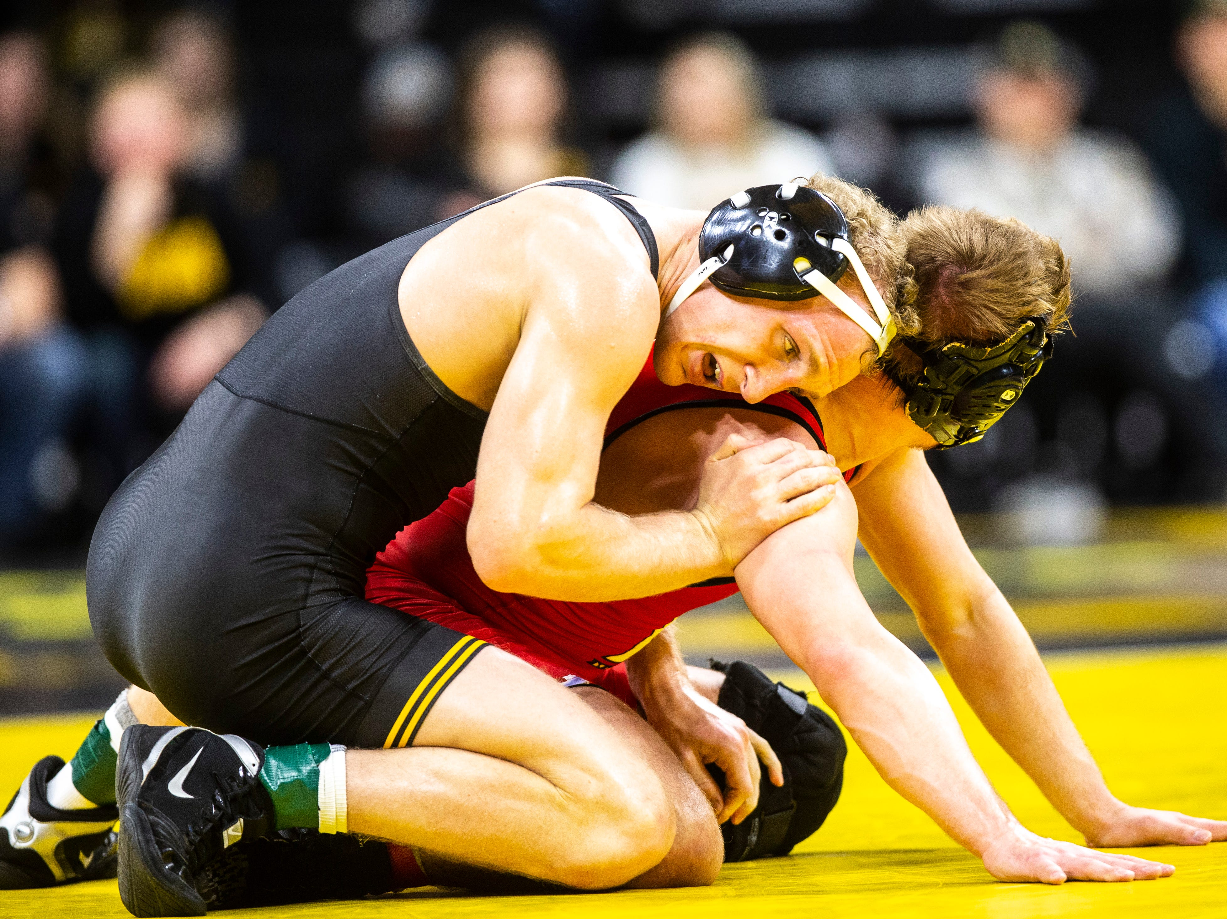 Iowa's Kaleb Young, left, wrestles Maryland's Ryan Diehl at 157 during a NCAA Big Ten Conference wrestling dual on Friday, Feb. 8, 2019 at Carver-Hawkeye Arena in Iowa City, Iowa.