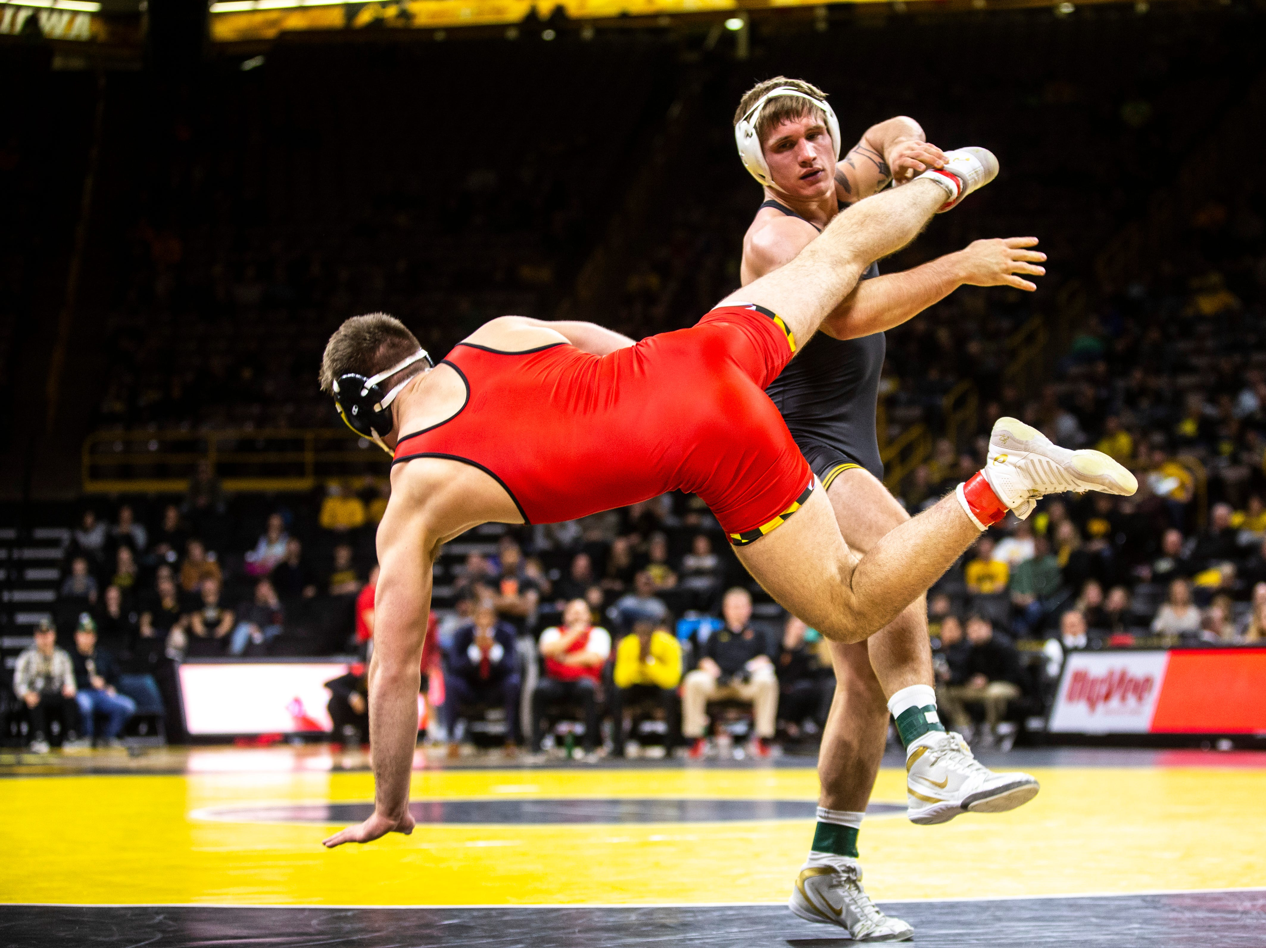 Iowa's Cash Wilcke, right, wrestles Maryland's Kyle Jasenski at 184 during a NCAA Big Ten Conference wrestling dual on Friday, Feb. 8, 2019 at Carver-Hawkeye Arena in Iowa City, Iowa.