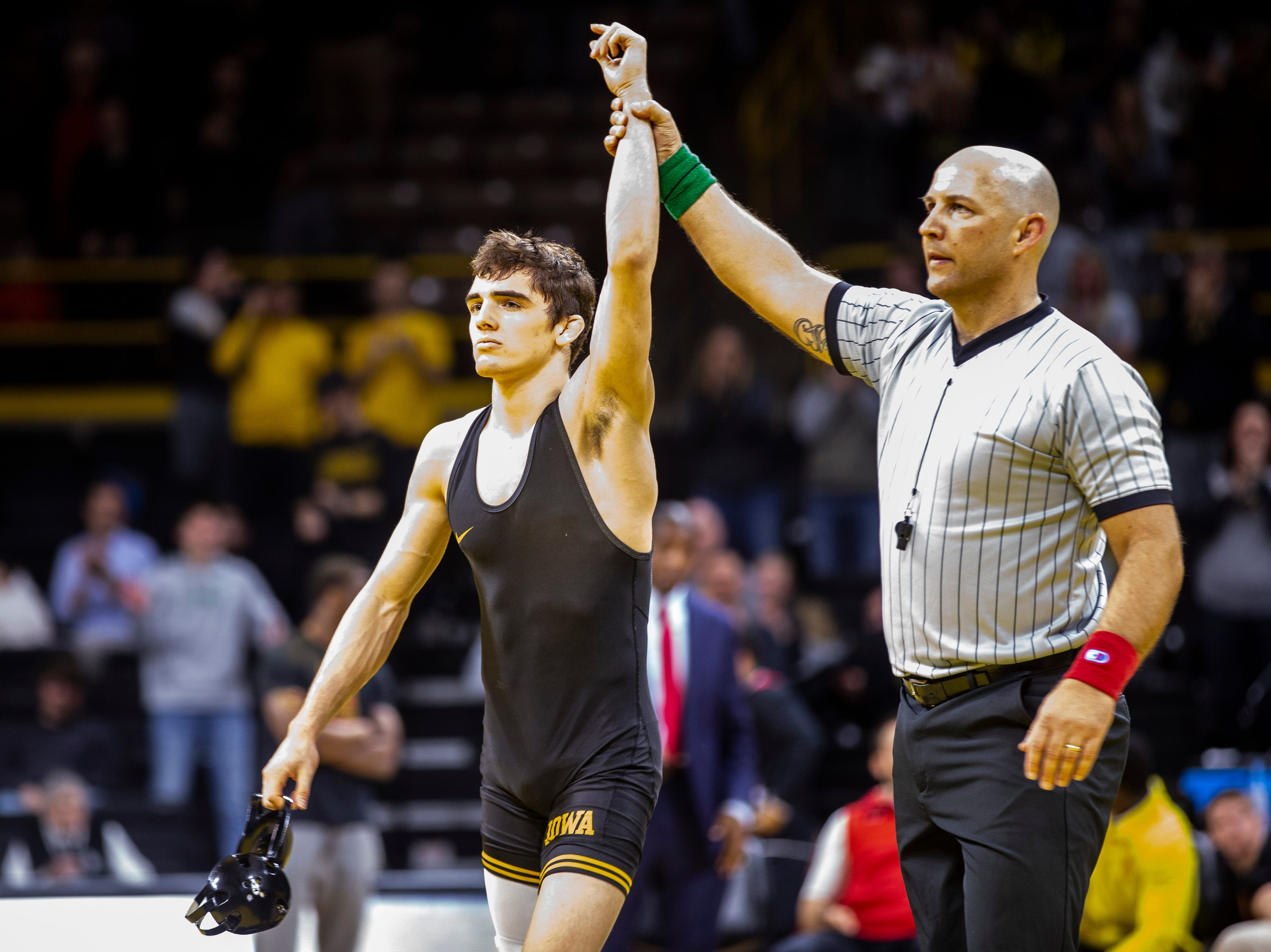 Iowa's Paul Glynn has his hand raised after pinning Maryland's Orion Anderson at 133 during a NCAA Big Ten Conference wrestling dual on Friday, Feb. 8, 2019 at Carver-Hawkeye Arena in Iowa City, Iowa.