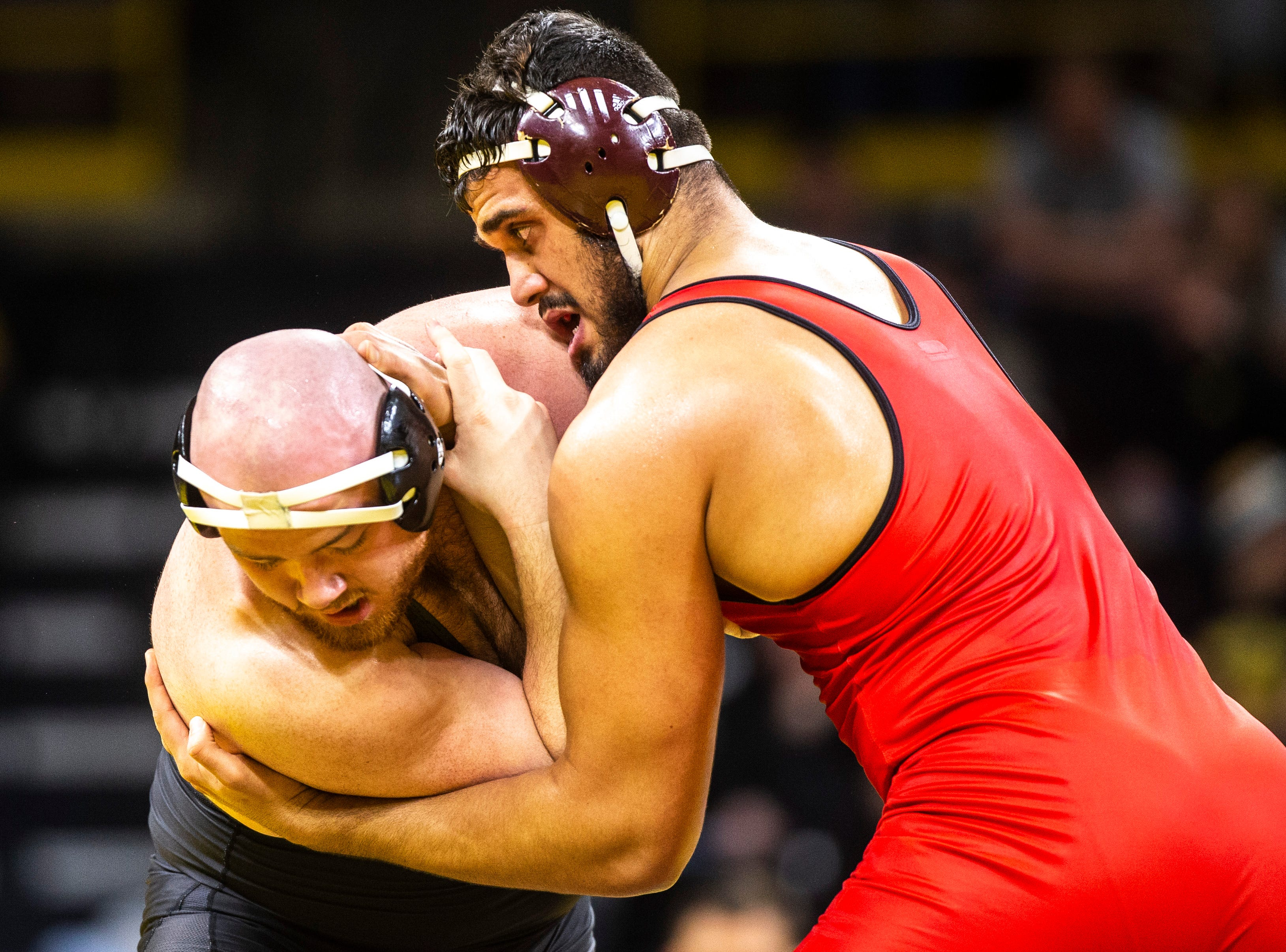 Iowa's Sam Stoll, left, wrestles Maryland's Youssif Hemida at 285 during a NCAA Big Ten Conference wrestling dual on Friday, Feb. 8, 2019 at Carver-Hawkeye Arena in Iowa City, Iowa.