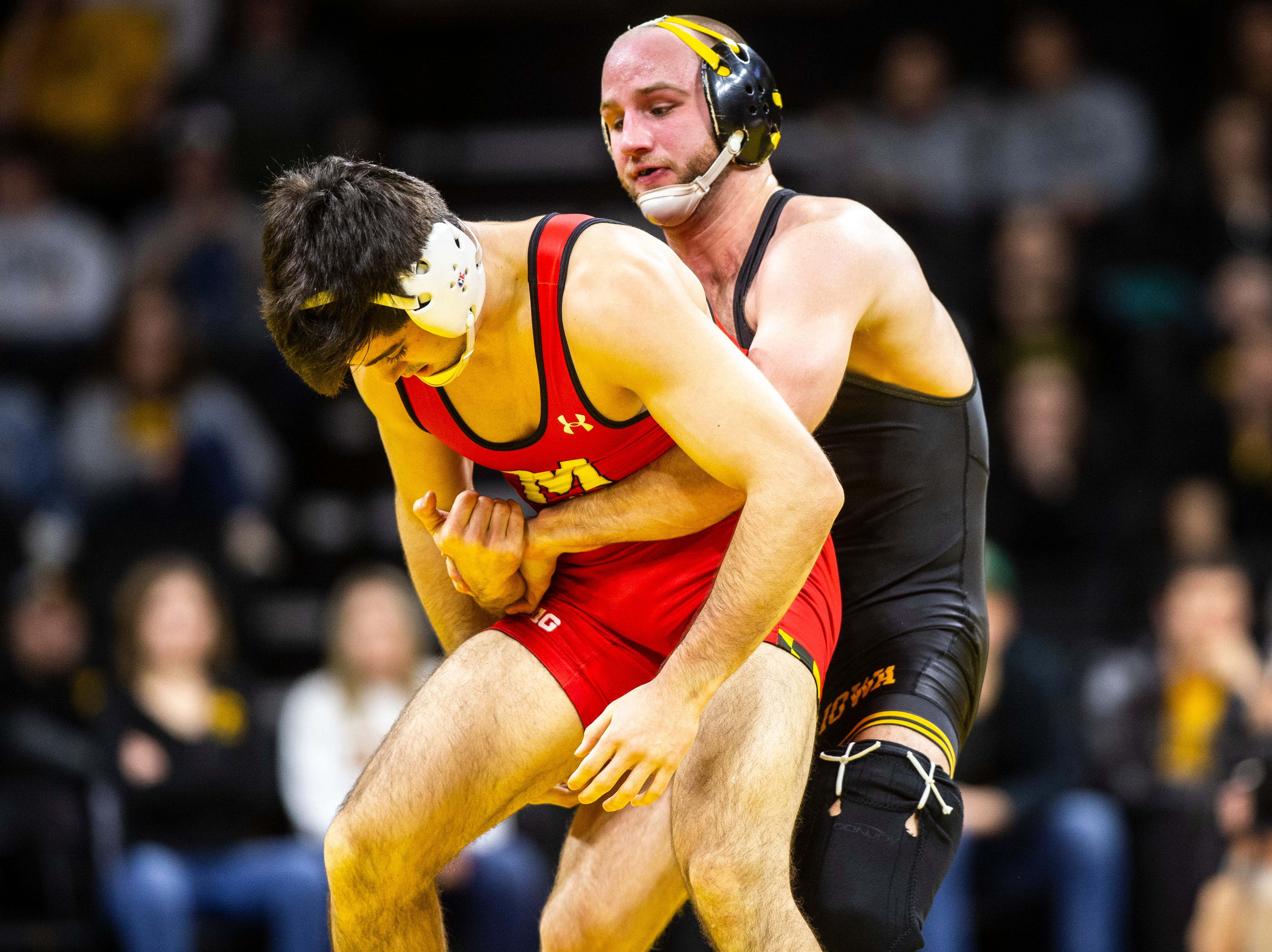 Iowa's Alex Marinelli, right, wrestles Maryland's Philip Spadafora at 165 during a NCAA Big Ten Conference wrestling dual on Friday, Feb. 8, 2019 at Carver-Hawkeye Arena in Iowa City, Iowa.