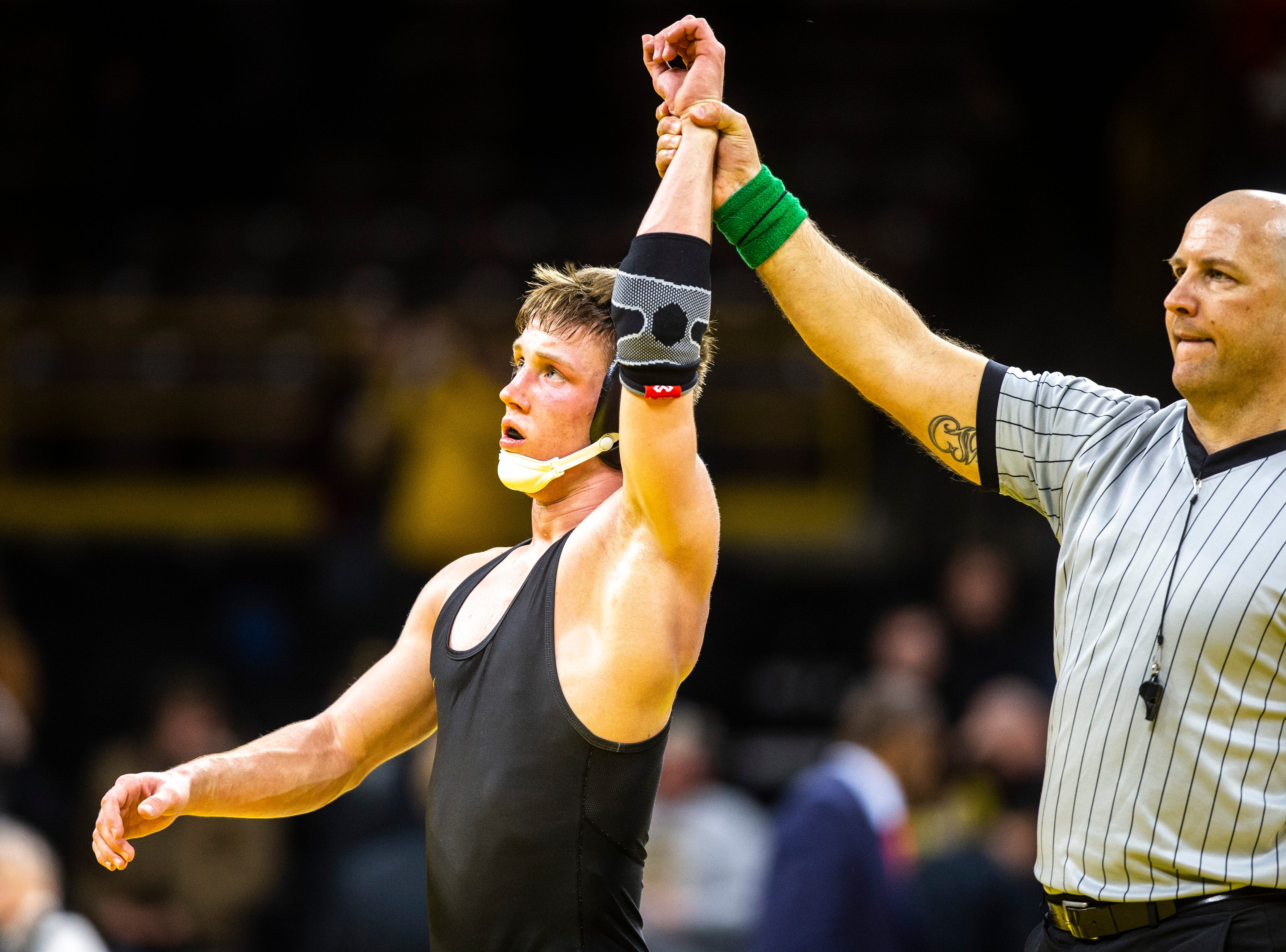 Iowa's Max Murin has his hand raised after scoring a major decision over Maryland's Danny Bertoni at 141 during a NCAA Big Ten Conference wrestling dual on Friday, Feb. 8, 2019 at Carver-Hawkeye Arena in Iowa City, Iowa.
