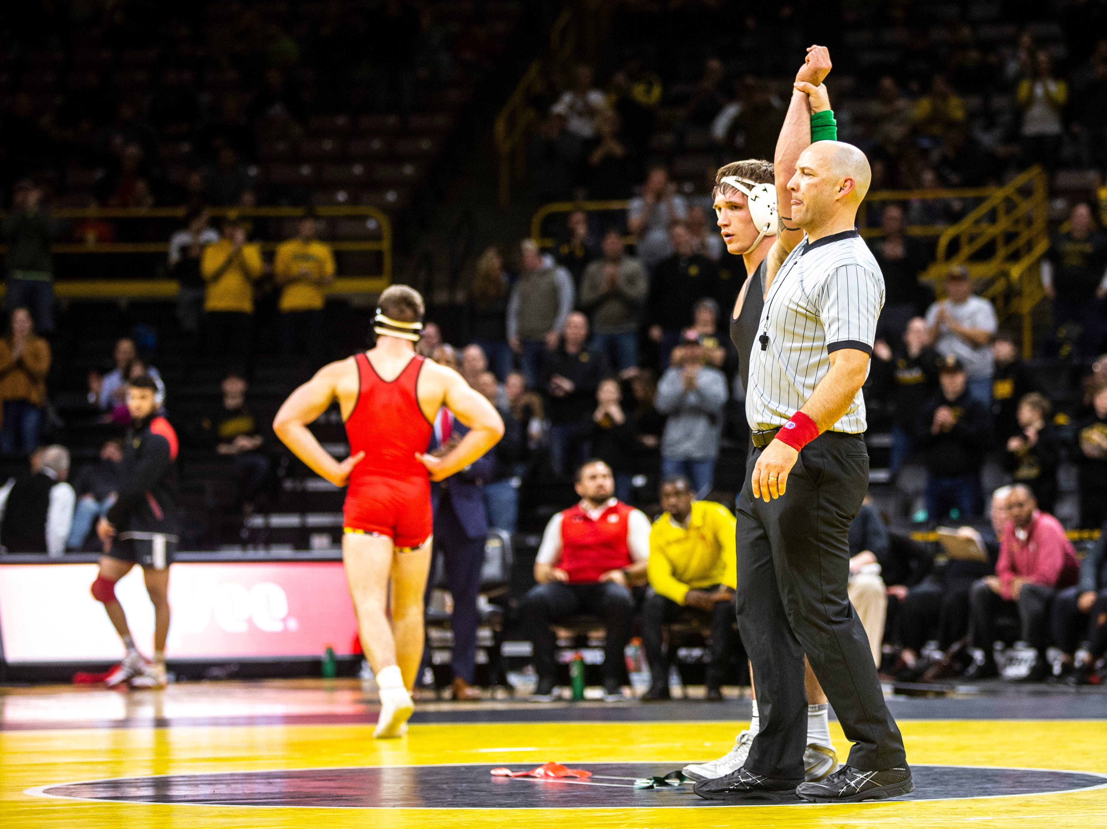 Iowa's Cash Wilcke has his hand raised after scoring a major decision over Maryland's Kyle Jasenski at 184 during a NCAA Big Ten Conference wrestling dual on Friday, Feb. 8, 2019 at Carver-Hawkeye Arena in Iowa City, Iowa.