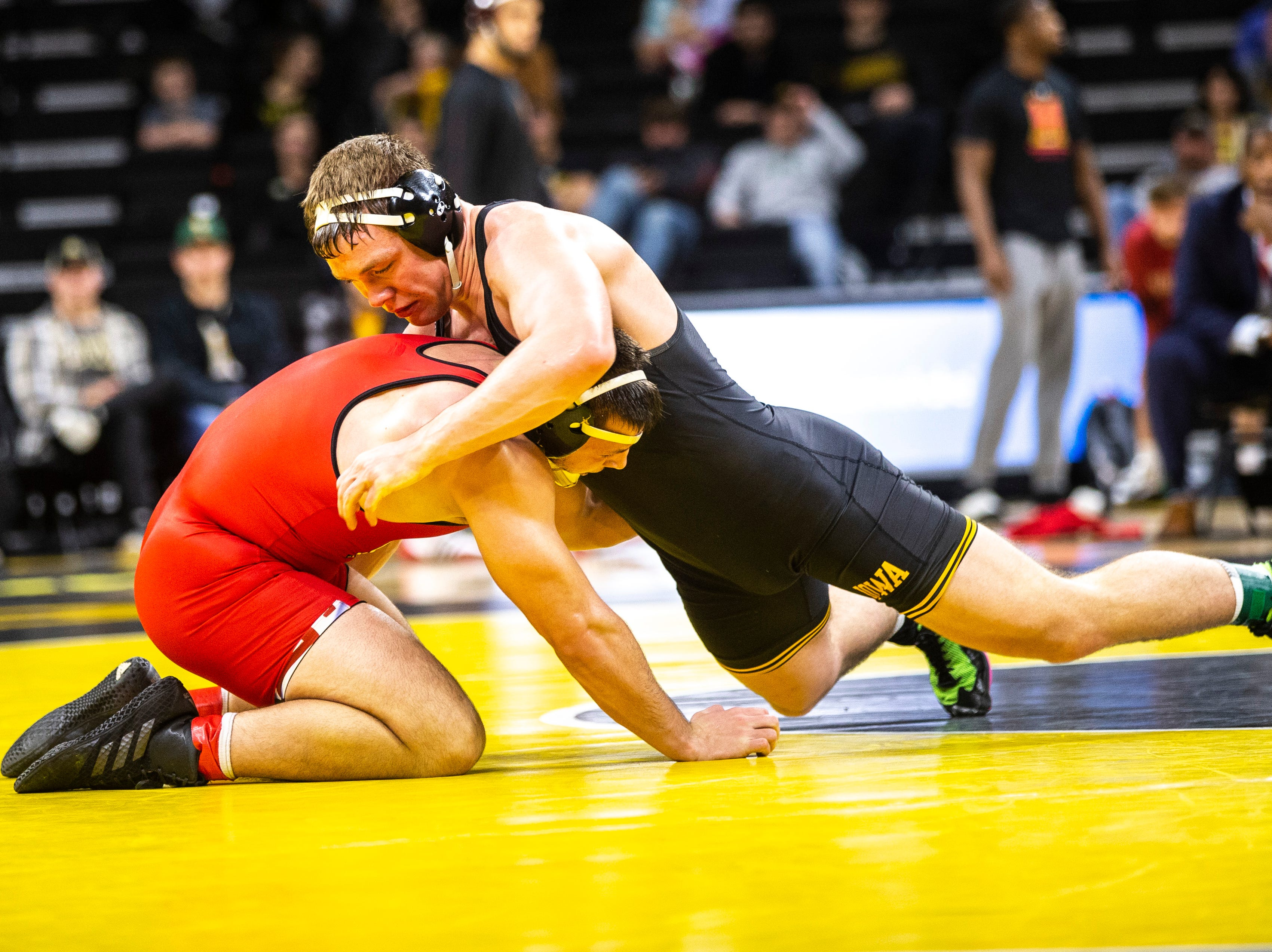 Iowa's Jacob Warner, right, wrestles Maryland's Niko Cappello at 197 during a NCAA Big Ten Conference wrestling dual on Friday, Feb. 8, 2019 at Carver-Hawkeye Arena in Iowa City, Iowa.
