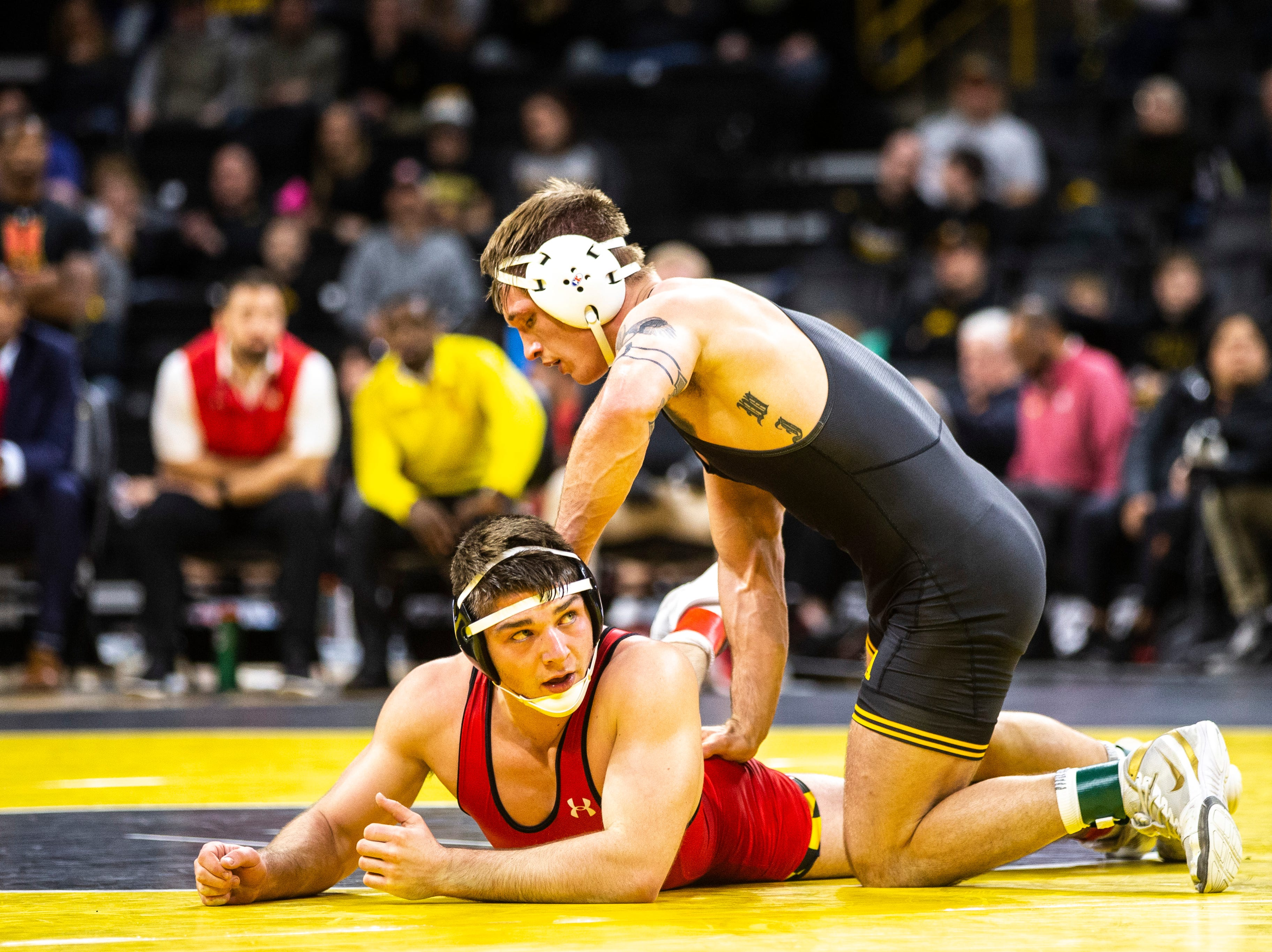 Iowa's Cash Wilcke wrestles Maryland's Kyle Jasenski at 184 during a NCAA Big Ten Conference wrestling dual on Friday, Feb. 8, 2019 at Carver-Hawkeye Arena in Iowa City, Iowa.