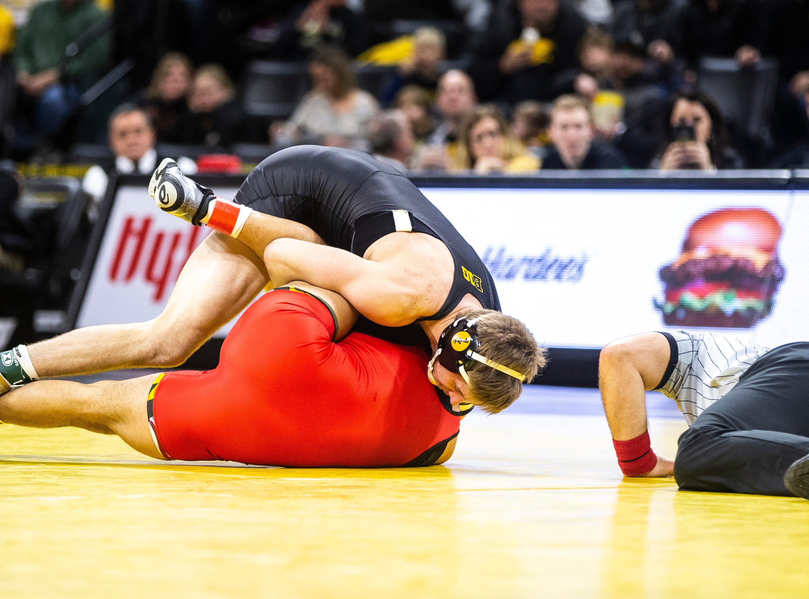 Iowa's Mitch Bowman works to pin Maryland's Josh Uglade at 174 during a NCAA Big Ten Conference wrestling dual on Friday, Feb. 8, 2019 at Carver-Hawkeye Arena in Iowa City, Iowa.