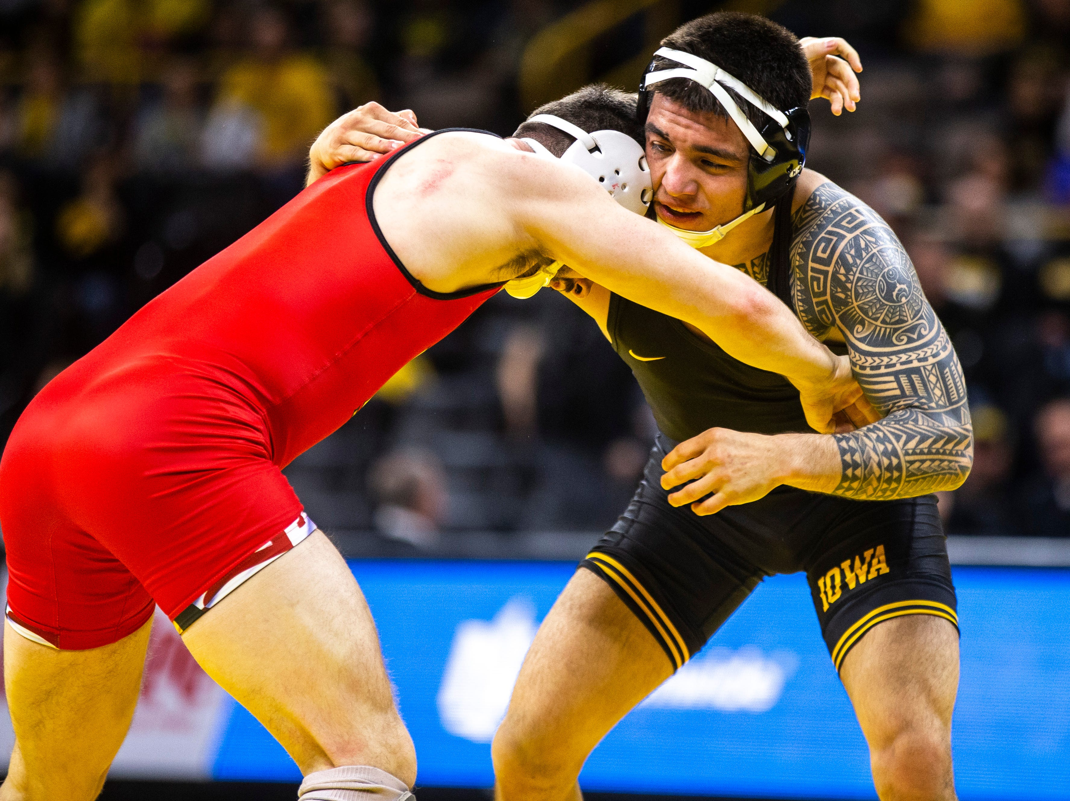Iowa's Pat Lugo, right, wrestles Maryland's Pete Tedesco at 149 during a NCAA Big Ten Conference wrestling dual on Friday, Feb. 8, 2019 at Carver-Hawkeye Arena in Iowa City, Iowa.