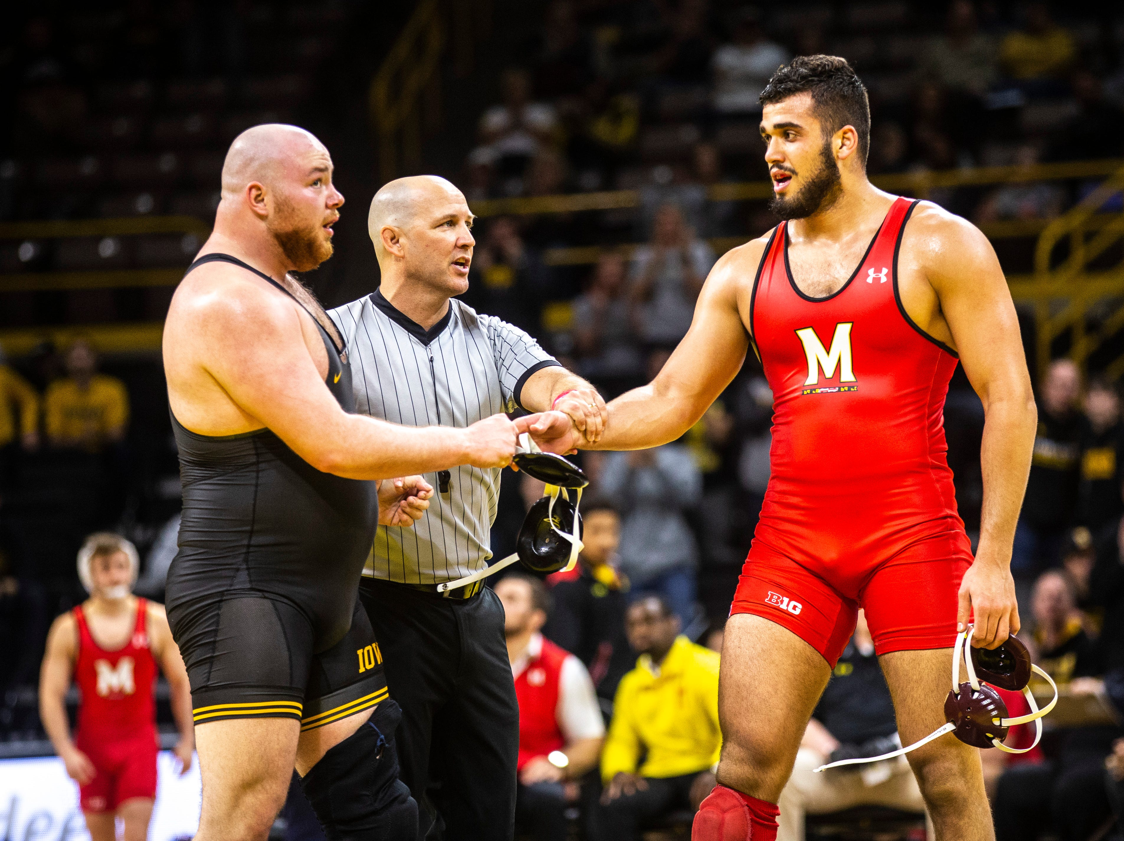 Iowa's Sam Stoll, left, shakes hands with Maryland's Youssif Hemida at 285 after scoring a 1-0 decision during a NCAA Big Ten Conference wrestling dual on Friday, Feb. 8, 2019 at Carver-Hawkeye Arena in Iowa City, Iowa.