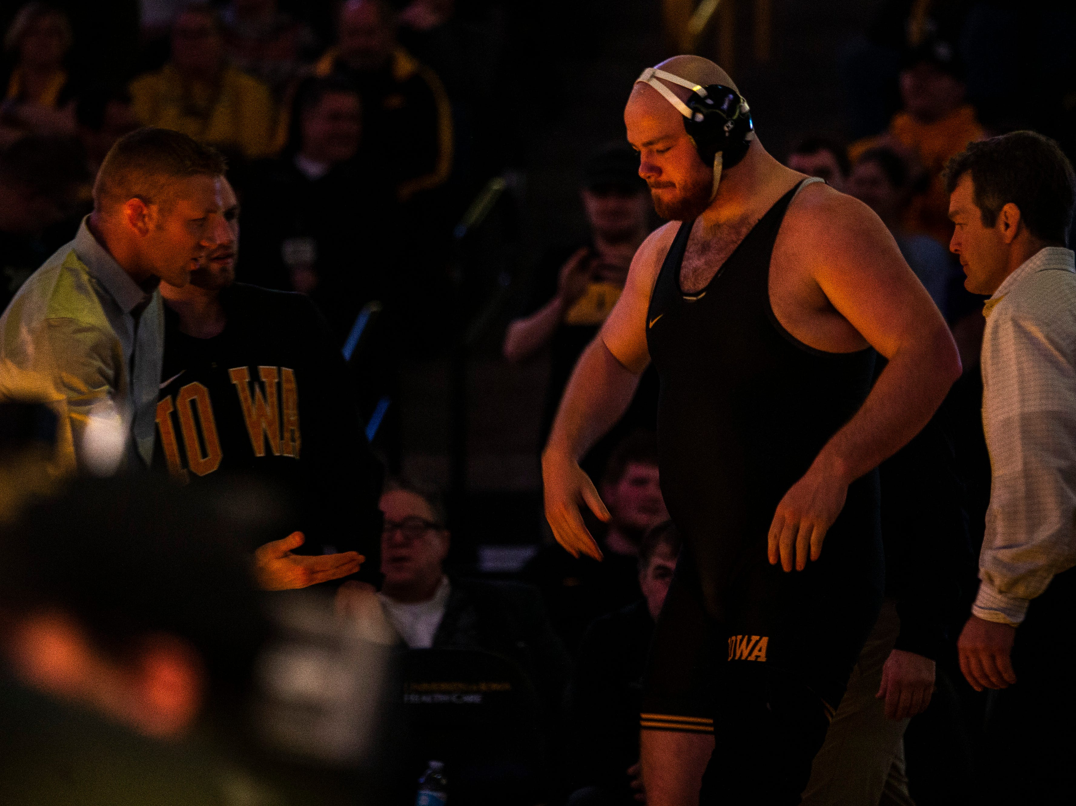 Iowa's Sam Stoll gets a high-five from assistant Ryan Morningstar, left, before a match a 285 during a NCAA Big Ten Conference wrestling dual on Friday, Feb. 8, 2019 at Carver-Hawkeye Arena in Iowa City, Iowa.