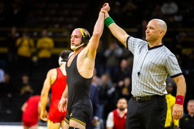 Iowa's Alex Marinelli has his hand raised after scoring a decision over Maryland's Philip Spadafora at 165 during a NCAA Big Ten Conference wrestling dual on Friday, Feb. 8, 2019 at Carver-Hawkeye Arena in Iowa City, Iowa.