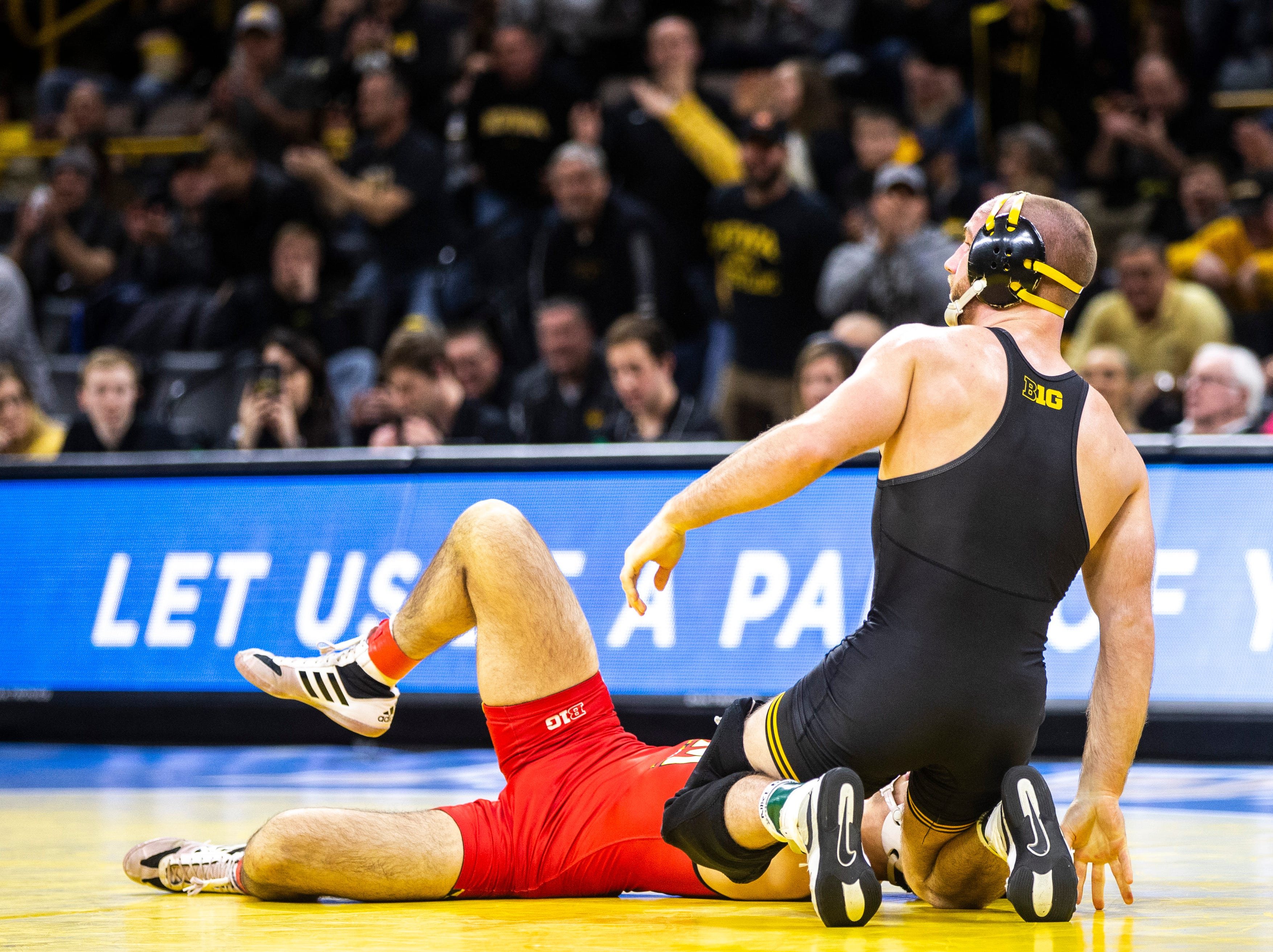 Iowa's Alex Marinelli, right, reacts after pinning Maryland's Philip Spadafora at 165 during a NCAA Big Ten Conference wrestling dual on Friday, Feb. 8, 2019 at Carver-Hawkeye Arena in Iowa City, Iowa.