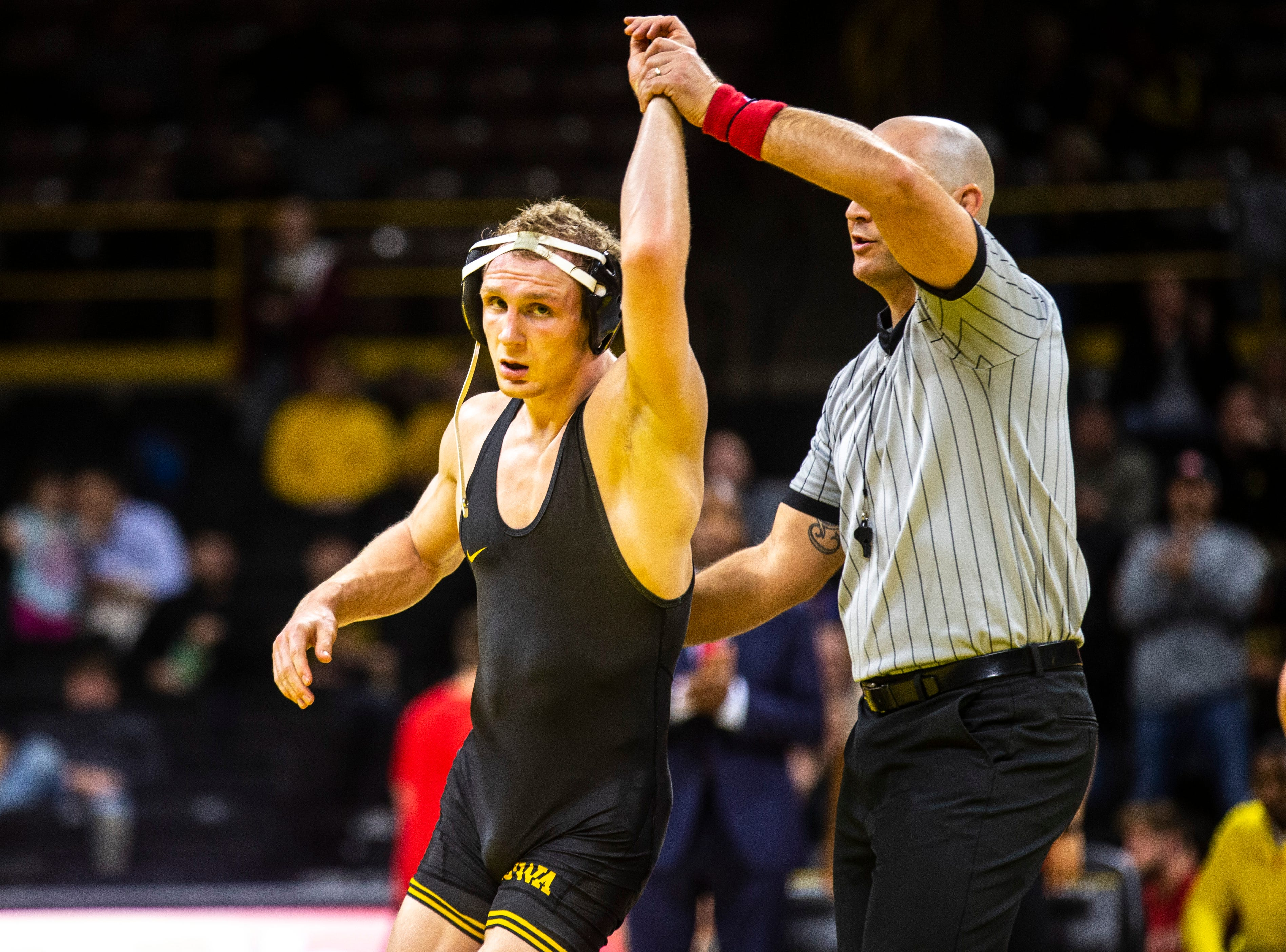 Iowa's Kaleb Young has his hand raised after scoring a decision over Maryland's Ryan Diehl at 157 during a NCAA Big Ten Conference wrestling dual on Friday, Feb. 8, 2019 at Carver-Hawkeye Arena in Iowa City, Iowa.
