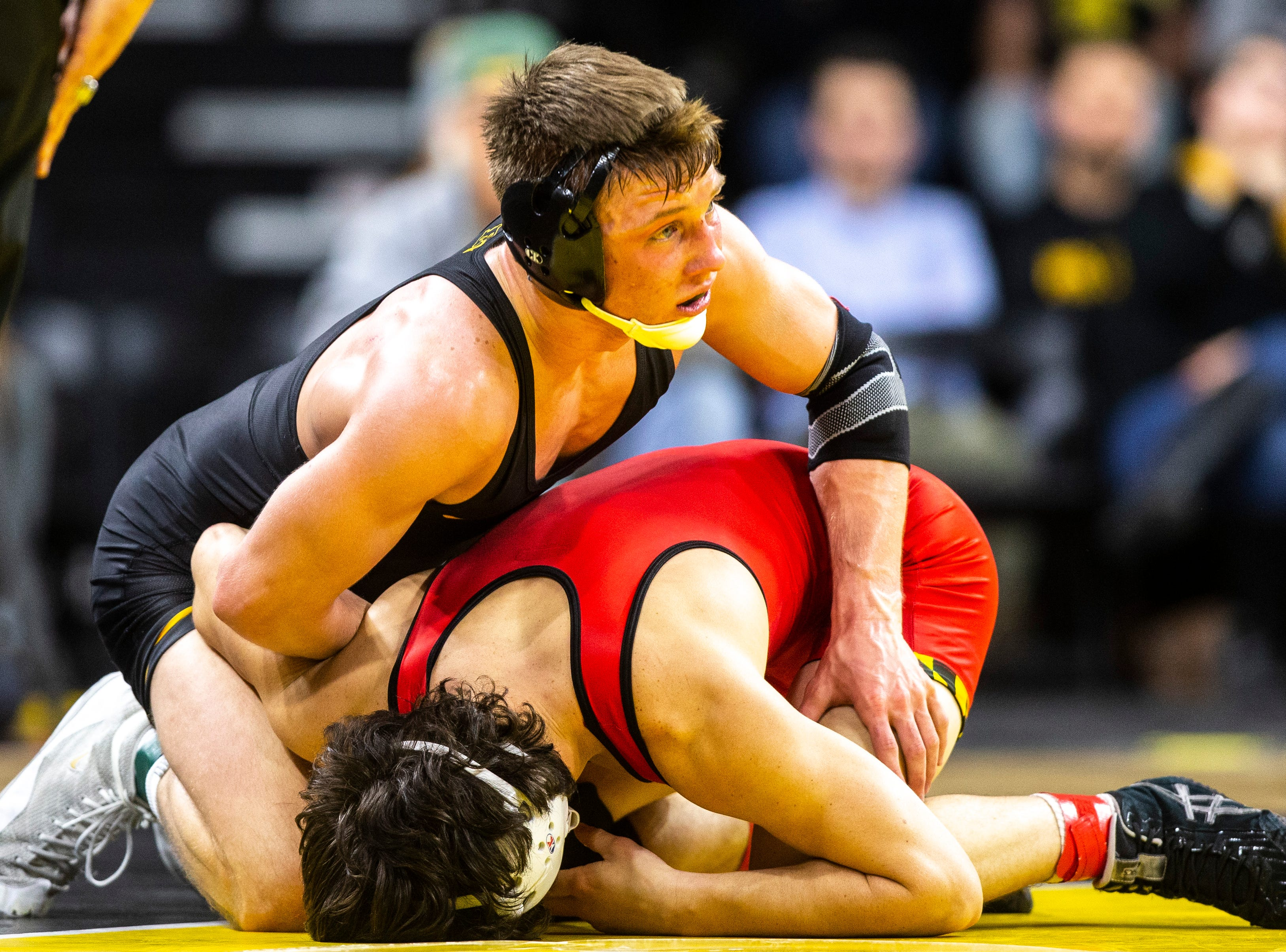 Iowa's Max Murin, top, wrestles Maryland's Danny Bertoni at 141 during a NCAA Big Ten Conference wrestling dual on Friday, Feb. 8, 2019 at Carver-Hawkeye Arena in Iowa City, Iowa.