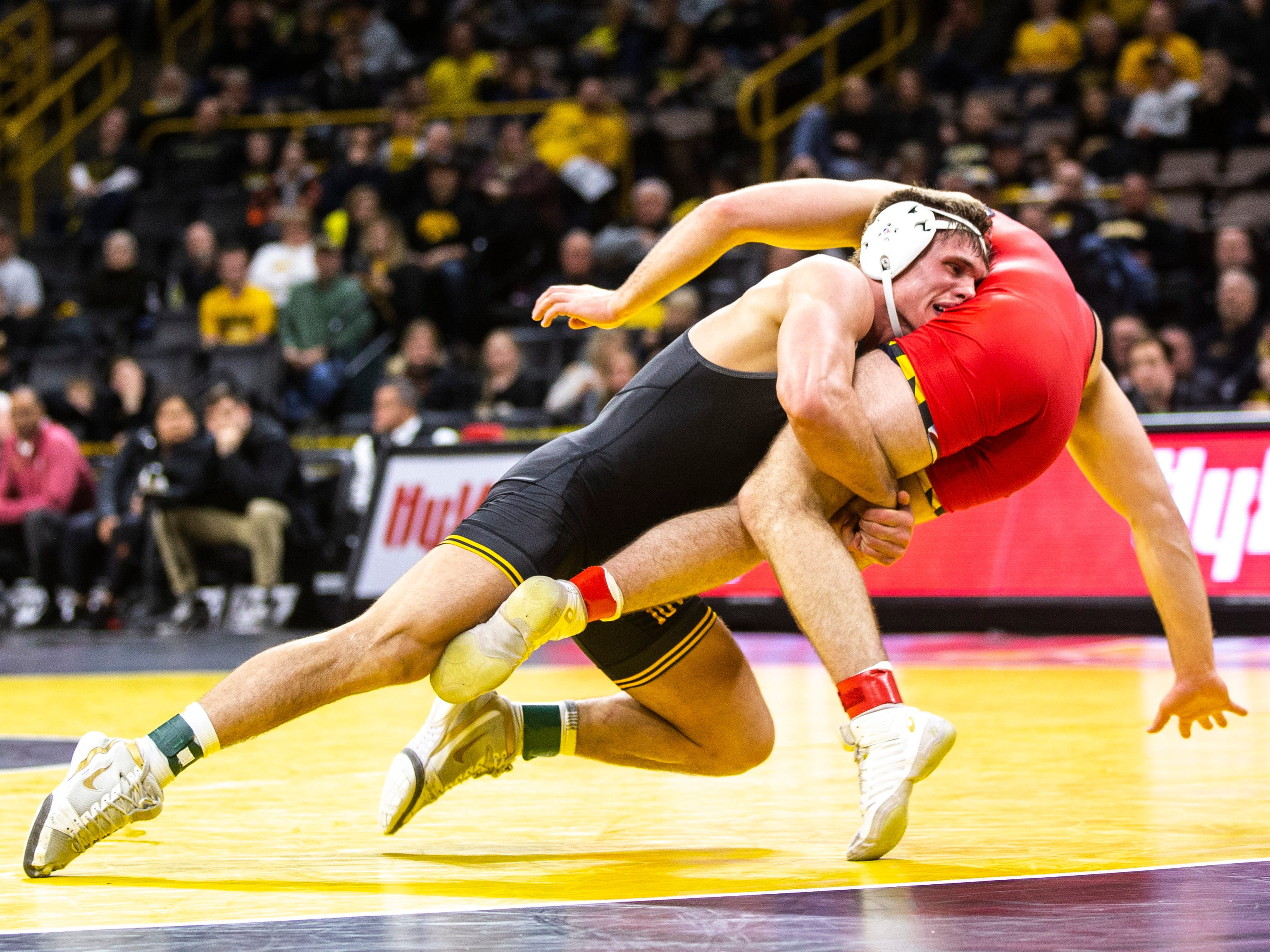 Iowa's Cash Wilcke, left, scores a takedown on Maryland's Kyle Jasenski at 184 during a NCAA Big Ten Conference wrestling dual on Friday, Feb. 8, 2019 at Carver-Hawkeye Arena in Iowa City, Iowa.