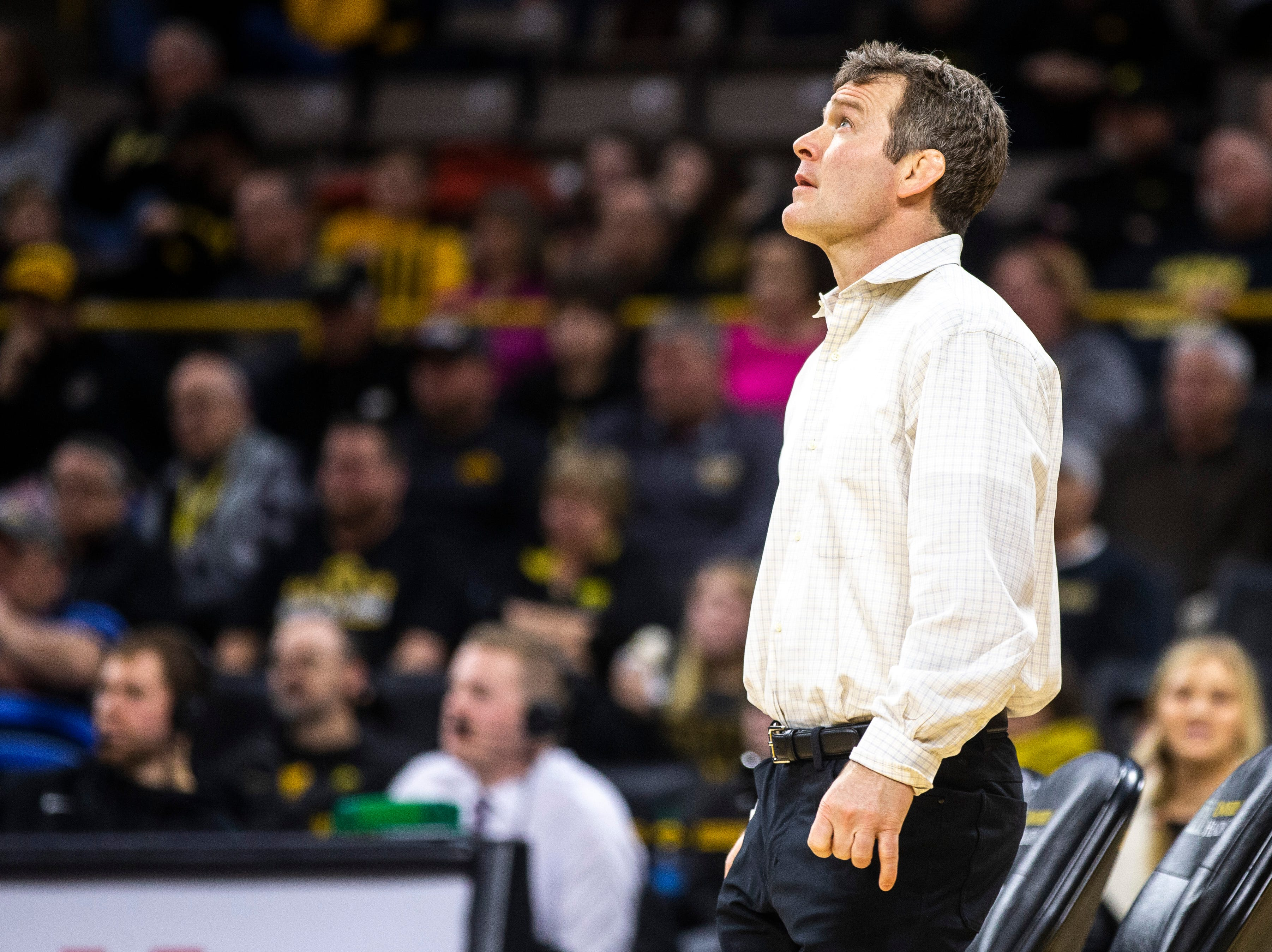 Iowa head coach Tom Brands looks up at the scoreboard during a NCAA Big Ten Conference wrestling dual on Friday, Feb. 8, 2019 at Carver-Hawkeye Arena in Iowa City, Iowa.