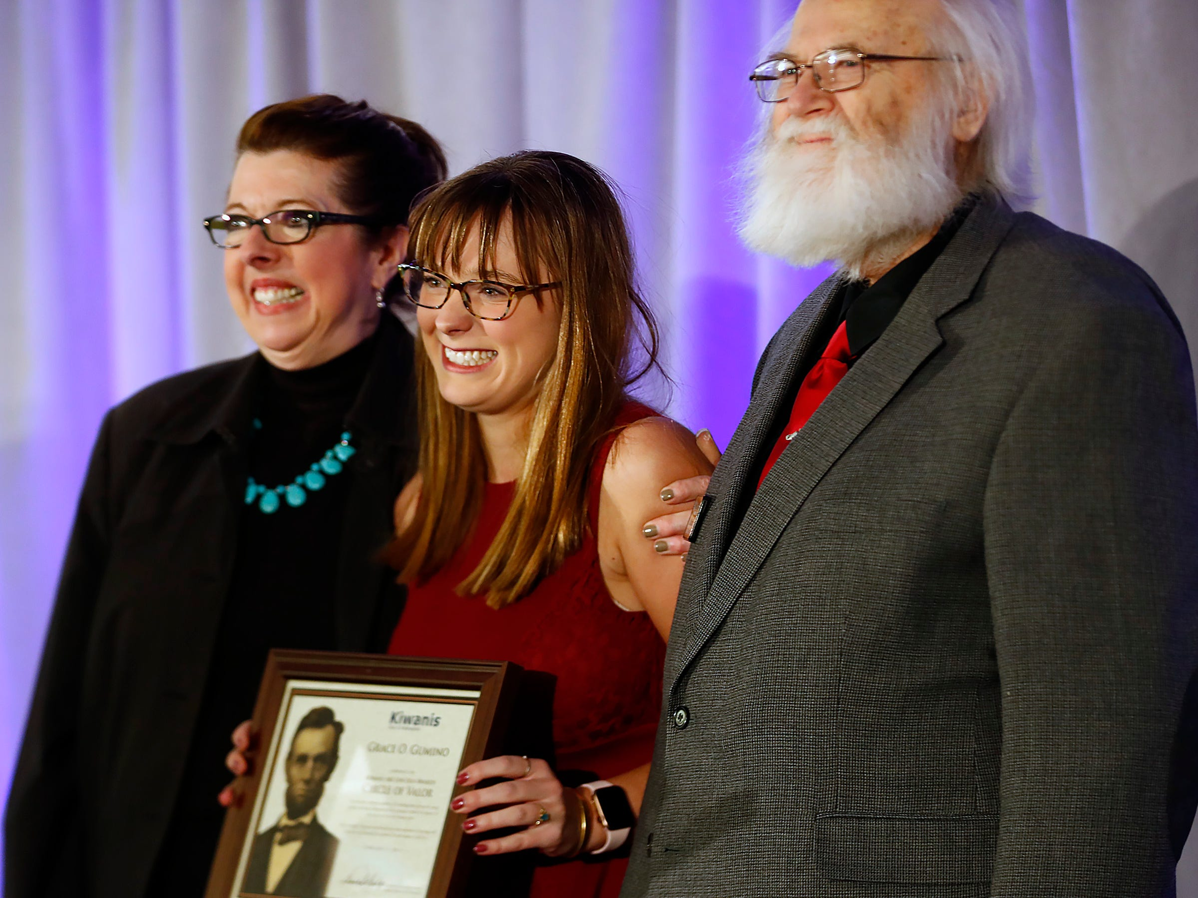 Cathedral High School student Grace Gumino, center, is honored with a Circle of Valor award at the 44th Annual Abe Lincoln Awards Program, Friday, Feb. 8, 2019. The Kiwanis Club of Indianapolis program was held at Ivy Tech Community College.  20 high school student were honored at the annual event which celebrates overcoming adversity in life to succeed.