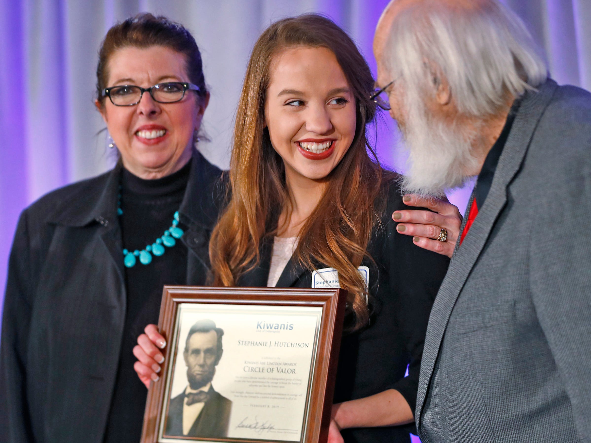 Franklin Central High School student Stephanie Hutchison, center, is honored with a Circle of Valor award at the 44th Annual Abe Lincoln Awards Program, Friday, Feb. 8, 2019. The Kiwanis Club of Indianapolis program was held at Ivy Tech Community College.  20 high school student were honored at the annual event which celebrates overcoming adversity in life to succeed.