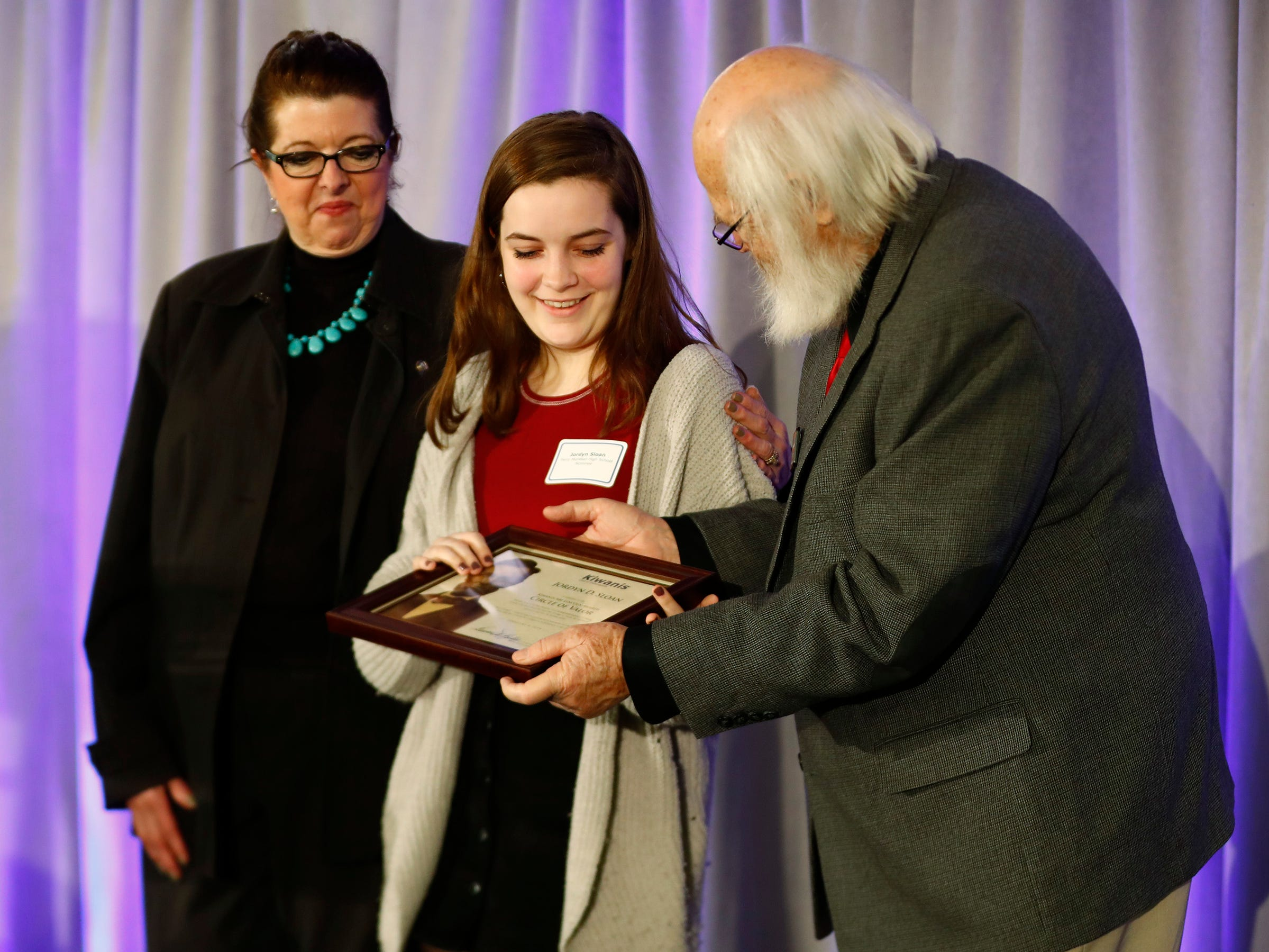 Perry Meridian High School's Jordyn Sloan, center, is honored with a Circle of Valor award at the 44th Annual Abe Lincoln Awards Program, Friday, Feb. 8, 2019. The Kiwanis Club of Indianapolis program was held at Ivy Tech Community College.  20 high school student were honored at the annual event which celebrates overcoming adversity in life to succeed.