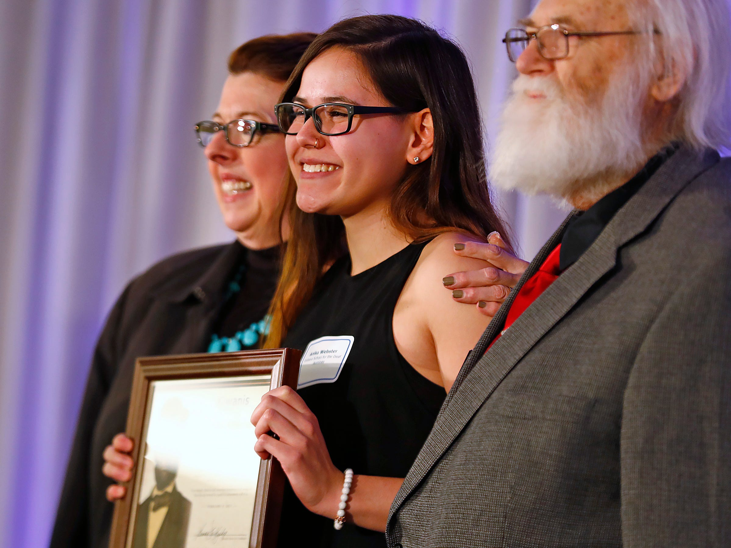 Indiana School for the Deaf student Anika Webster, center, is honored with a Circle of Valor award at the 44th Annual Abe Lincoln Awards Program, Friday, Feb. 8, 2019. The Kiwanis Club of Indianapolis program was held at Ivy Tech Community College.  20 high school student were honored at the annual event which celebrates overcoming adversity in life to succeed.