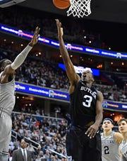 Butler Bulldogs guard Kamar Baldwin (3) shoots against Georgetown Hoyas forward Josh LeBlanc (23) during the first half at Capital One Arena.