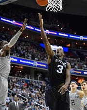 Butler Bulldogs guard Kamar Baldwin (3) shoots against Georgetown Hoyas forward Josh LeBlanc (23) during the first half at Capital One Arena.