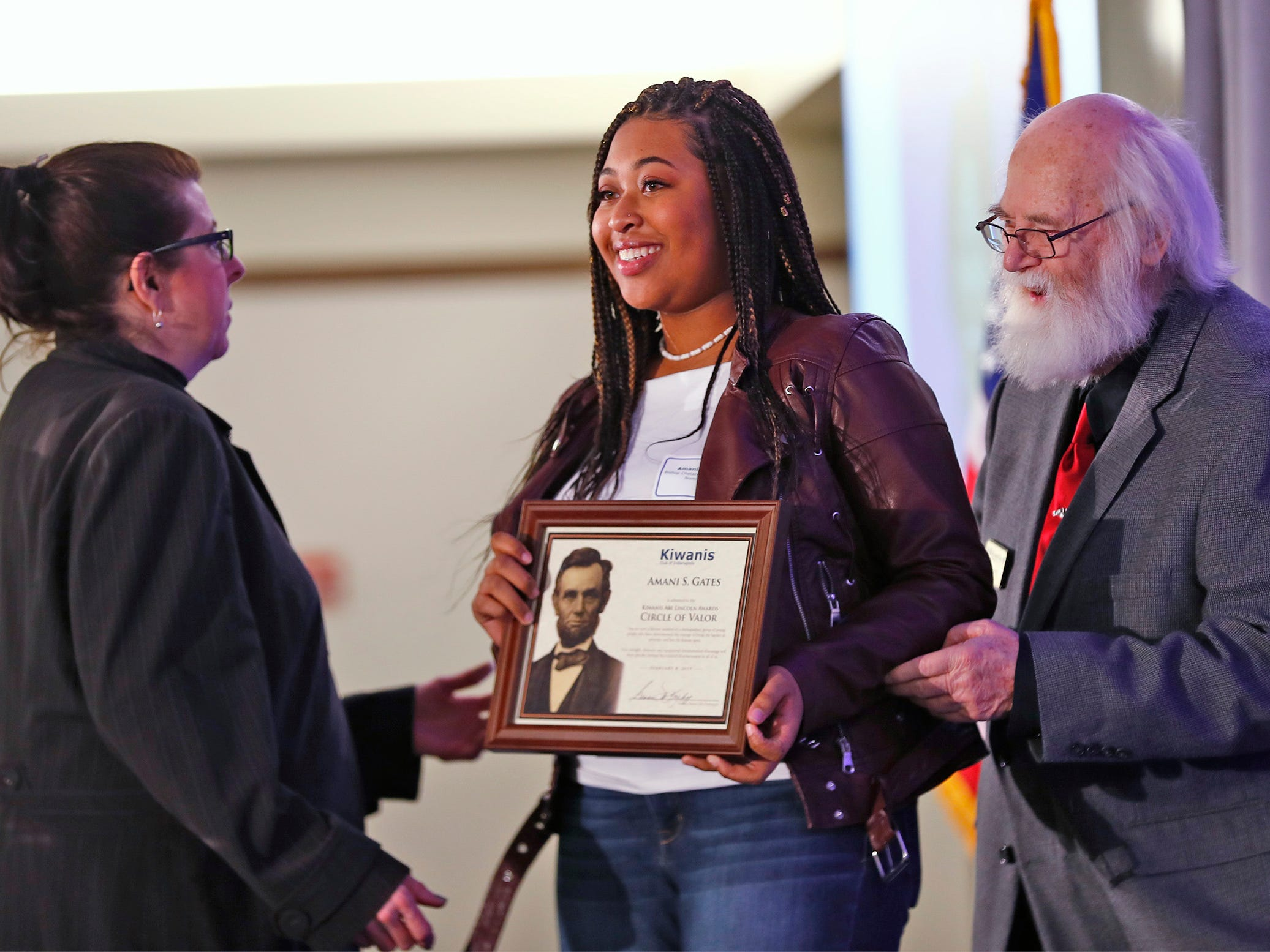 Bishop Chatard High School student Amani Gates, center, is honored with a Circle of Valor award at the 44th Annual Abe Lincoln Awards Program, Friday, Feb. 8, 2019. The Kiwanis Club of Indianapolis program was held at Ivy Tech Community College.  20 high school student were honored at the annual event which celebrates overcoming adversity in life to succeed.