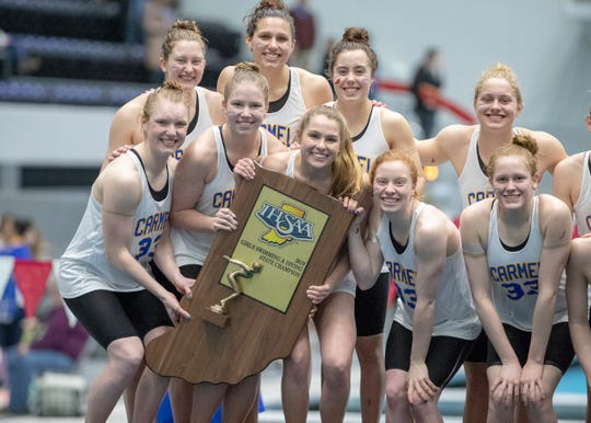 Carmel High School celebrates after their title, IHSAA Girls State Swimming and Diving Finals, IUPUI Natatorium, Indianapolis, Saturday, Feb. 9, 2019. Carmel High School has won 33 straight state titles, extending their national record.
