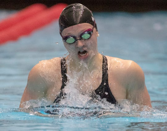 Emily Weiss of Yorktown High School, one of the strongest swimmers in the country, cruises to a victory in the 100 yard breaststroke, during the IHSAA Girls State Swimming and Diving Finals, IUPUI Natatorium, Indianapolis, Saturday, Feb. 9, 2019. Carmel High School, the team winner, has won 33 straight state titles, extending their national record.