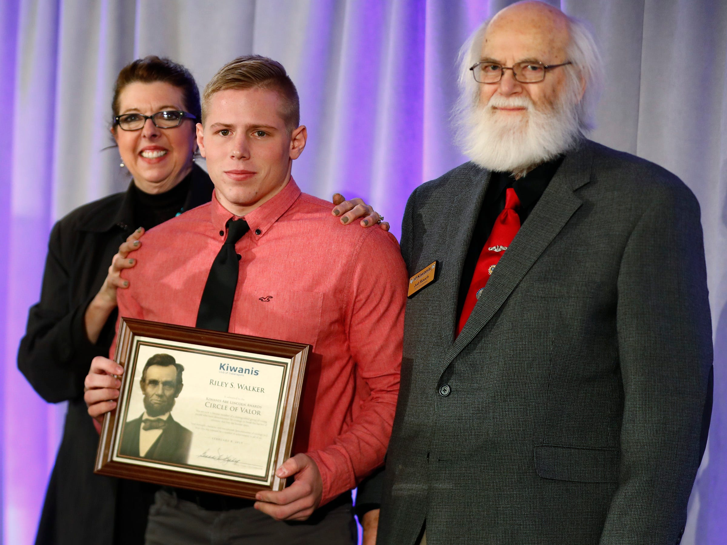 Speedway High School student Riley Walker, center, is honored with a Circle of Valor award at the 44th Annual Abe Lincoln Awards Program, Friday, Feb. 8, 2019. The Kiwanis Club of Indianapolis program was held at Ivy Tech Community College.  20 high school student were honored at the annual event which celebrates overcoming adversity in life to succeed.