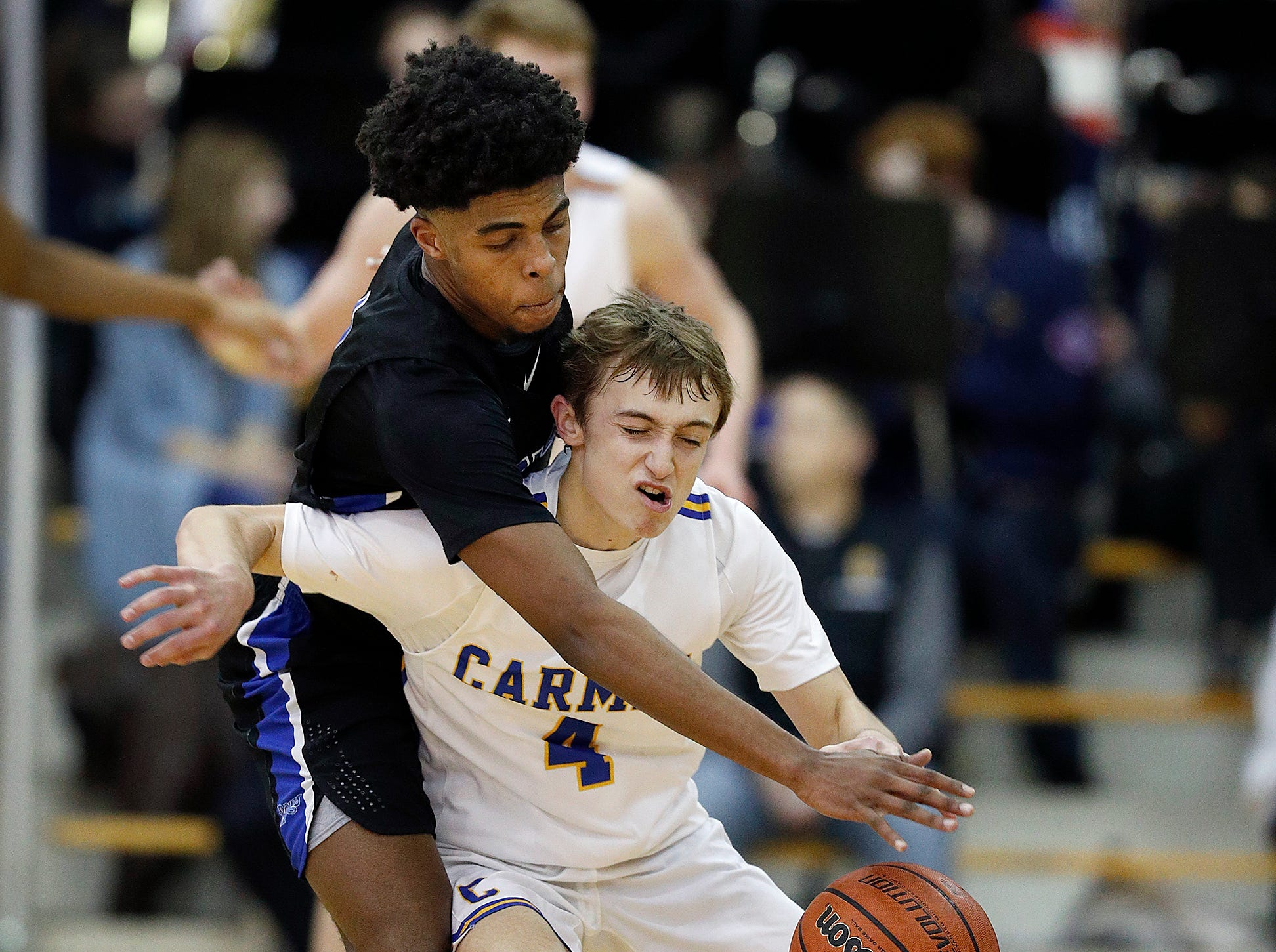 Hamilton Southeastern Royals Noah Smith (1) attempts to steal the ball from /c4/ in the second half of their game at Carmel High School on Friday, Feb. 8, 2019.