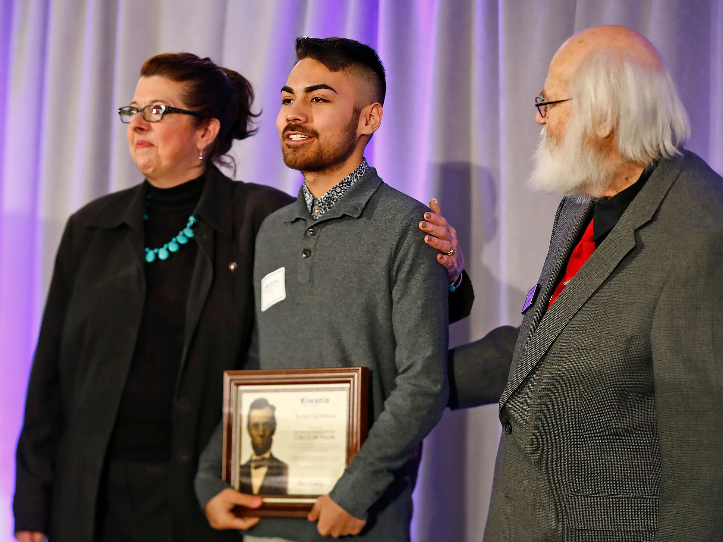Lawrence North High School student Blake Quiroga, center, is honored with a Circle of Valor award at the 44th Annual Abe Lincoln Awards Program, Friday, Feb. 8, 2019. The Kiwanis Club of Indianapolis program was held at Ivy Tech Community College.  20 high school student were honored at the annual event which celebrates overcoming adversity in life to succeed.
