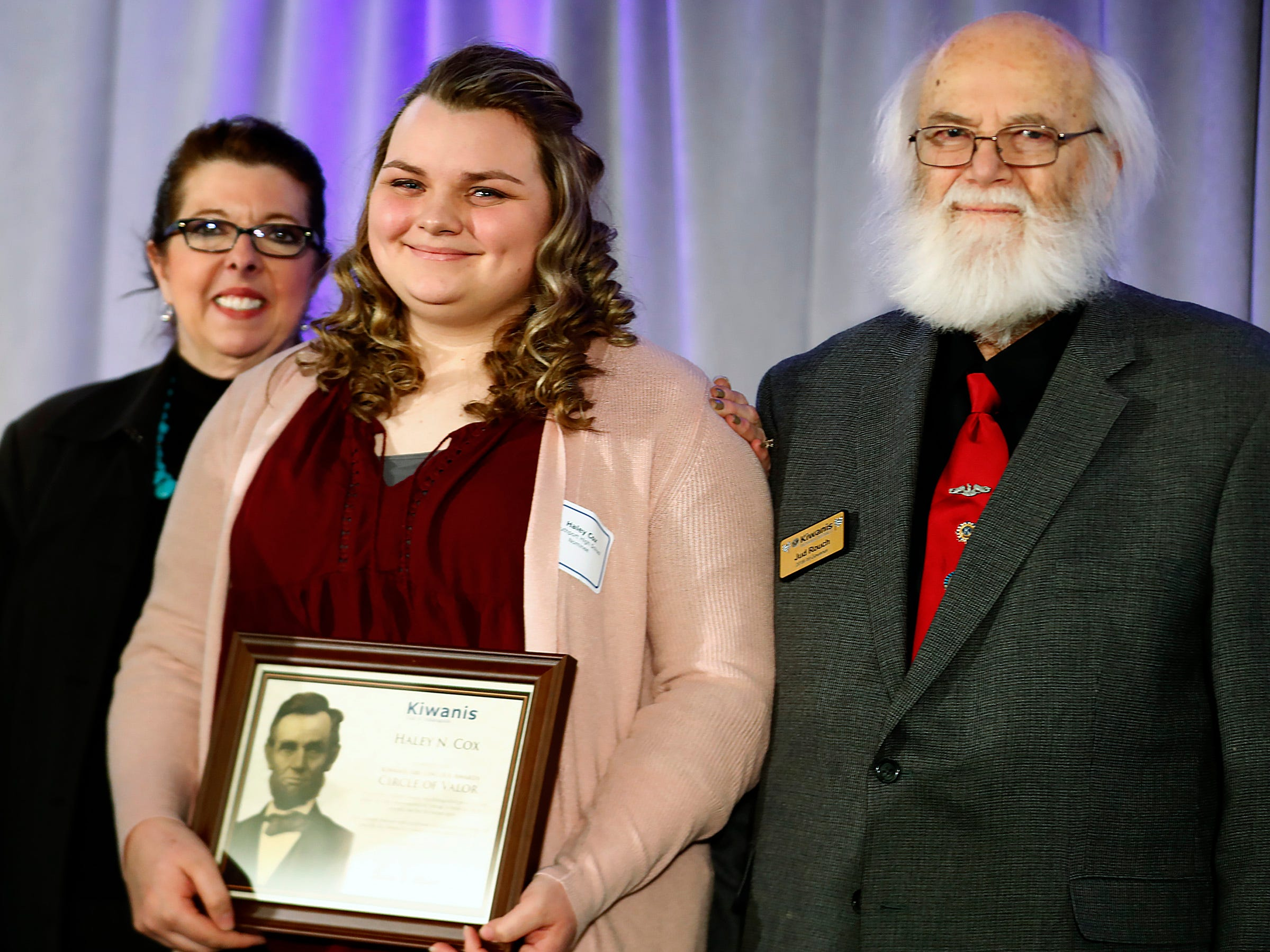 Southport High School student Haley Cox, center, is honored with a Circle of Valor award at the 44th Annual Abe Lincoln Awards Program, Friday, Feb. 8, 2019. The Kiwanis Club of Indianapolis program was held at Ivy Tech Community College.  20 high school student were honored at the annual event which celebrates overcoming adversity in life to succeed.