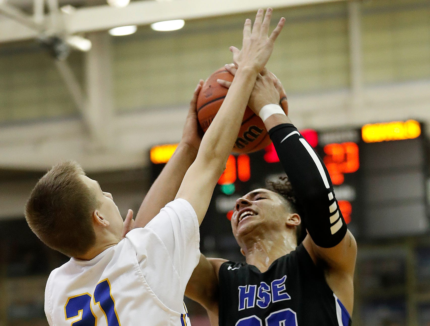 Hamilton Southeastern Royals Chris Grubbs (20) is fouled by Carmel Greyhounds Brian Waddell (21) in the second half of their game at Carmel High School on Friday, Feb. 8, 2019.