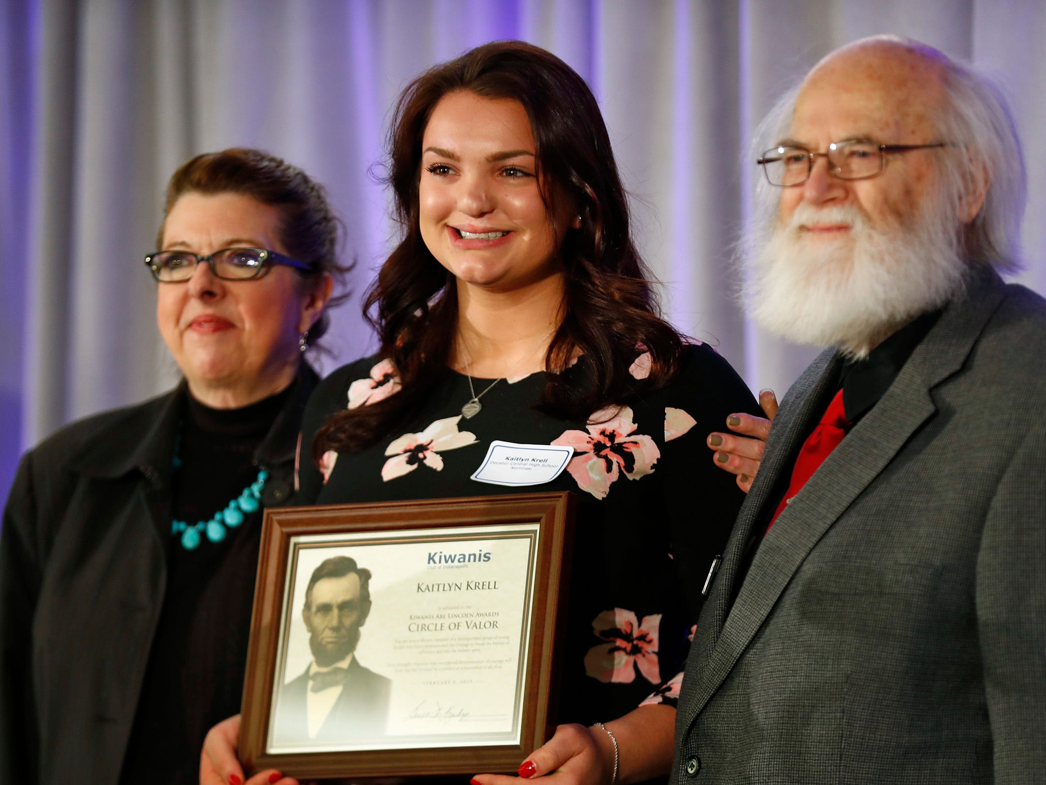 Decatur Central High School student Kaitlyn Krell, center, is honored with a Circle of Valor award at the 44th Annual Abe Lincoln Awards Program, Friday, Feb. 8, 2019. The Kiwanis Club of Indianapolis program was held at Ivy Tech Community College.  20 high school student were honored at the annual event which celebrates overcoming adversity in life to succeed.