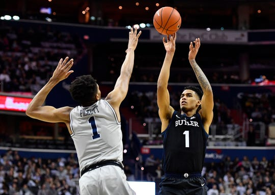 Butler Bulldogs forward Jordan Tucker (1) shoots against Georgetown Hoyas guard Jamorko Pickett (1) during the first half at Capital One Arena.