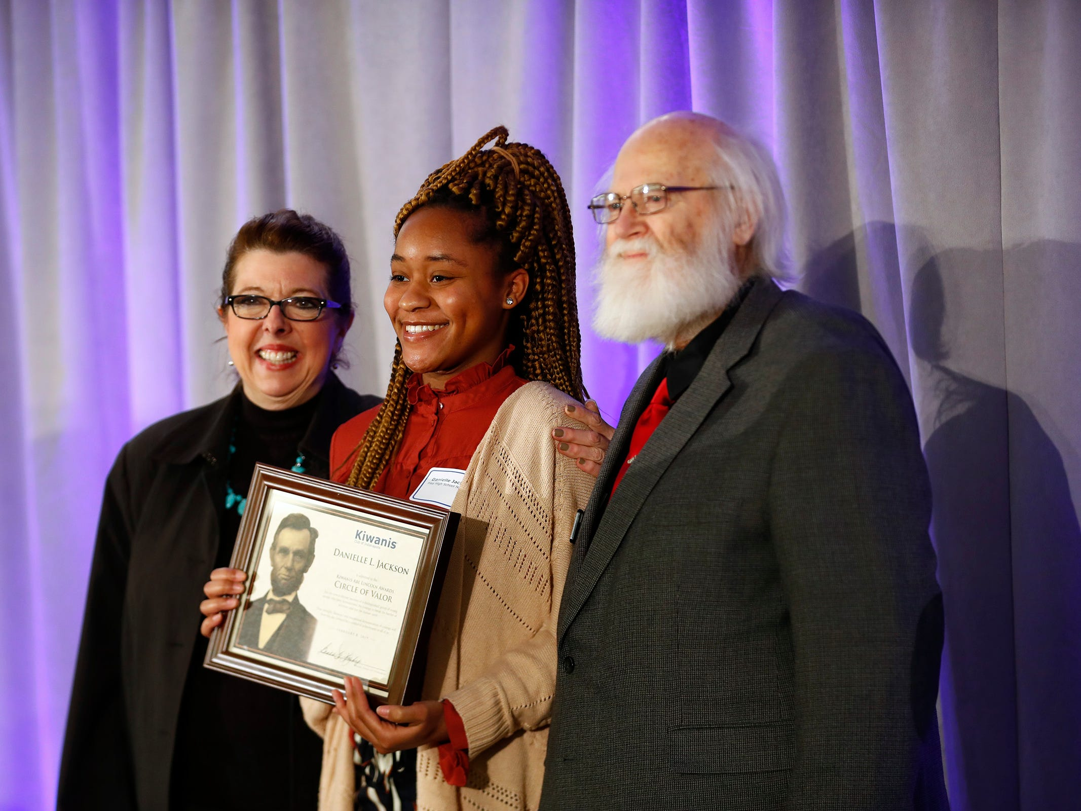 Danielle Jackson, center, is honored with a Circle of Valor award at the 44th Annual Abe Lincoln Awards Program, Friday, Feb. 8, 2019. The Kiwanis Club of Indianapolis program was held at Ivy Tech Community College.  20 high school student were honored at the annual event which celebrates overcoming adversity in life to succeed.