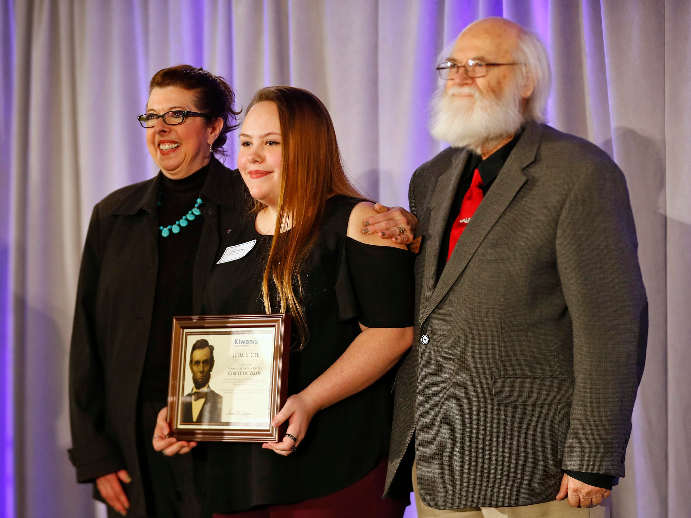 Beech Grove High School student Julia Reel, center, is honored with a Circle of Valor award at the 44th Annual Abe Lincoln Awards Program, Friday, Feb. 8, 2019. The Kiwanis Club of Indianapolis program was held at Ivy Tech Community College.  20 high school student were honored at the annual event which celebrates overcoming adversity in life to succeed.