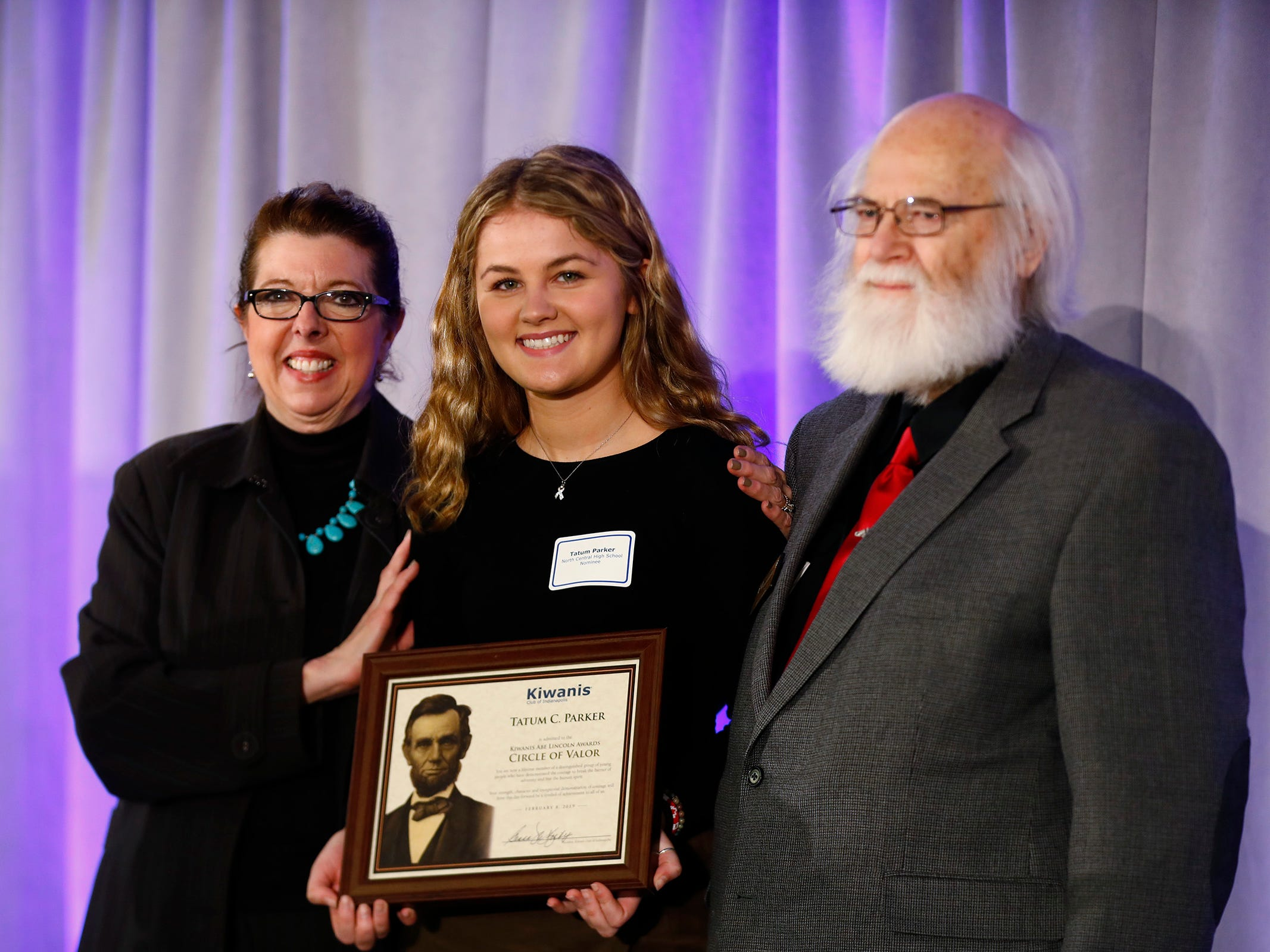 North Central High School student, Tatum Parker, center, is honored with a Circle of Valor award at the 44th Annual Abe Lincoln Awards Program, Friday, Feb. 8, 2019. The Kiwanis Club of Indianapolis program was held at Ivy Tech Community College.  20 high school student were honored at the annual event which celebrates overcoming adversity in life to succeed.