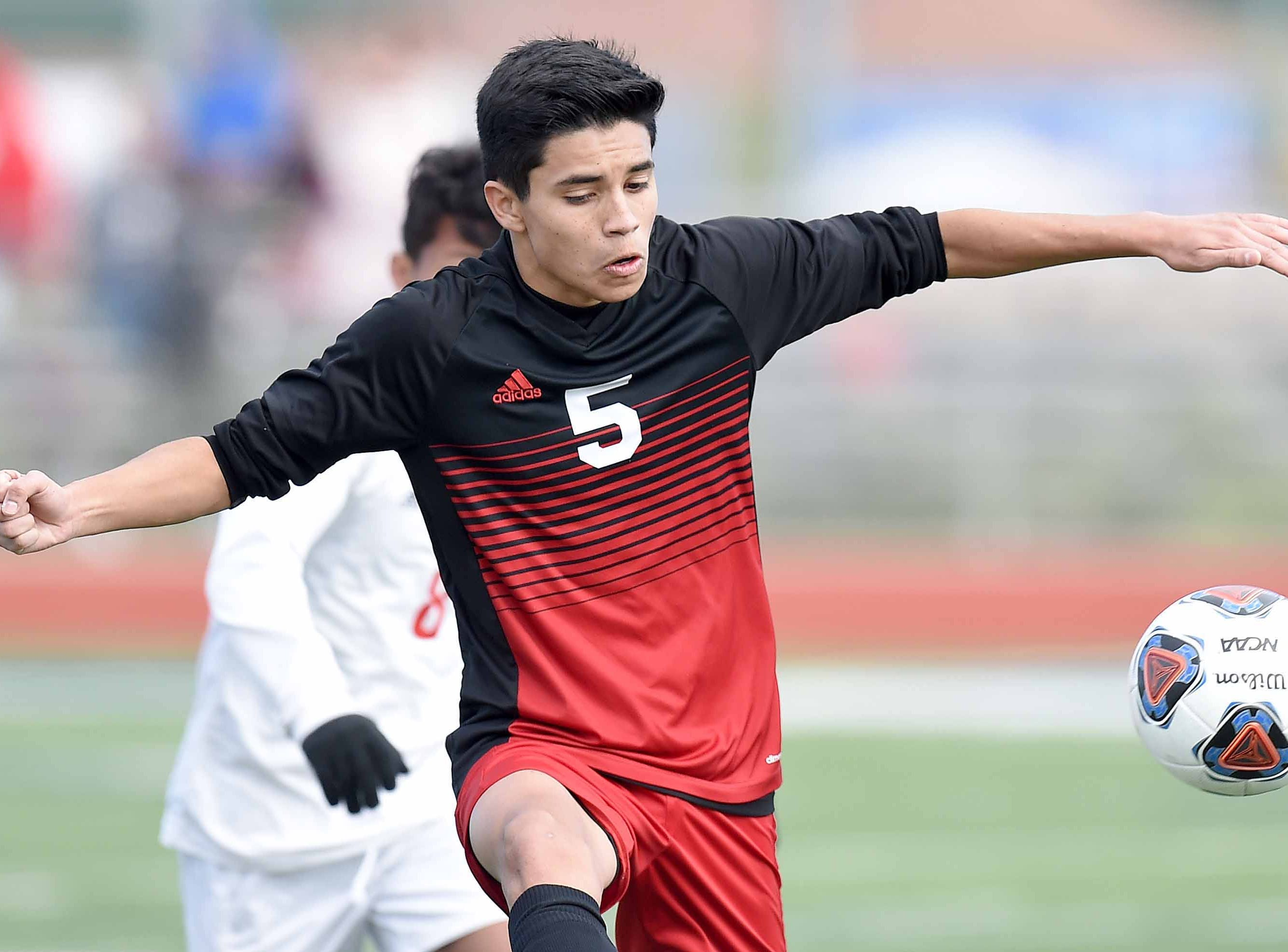 West Lauderdale's Daniel Galvan (5) intercepts a Richland pass in the Class 4A state championship in the MHSAA BlueCross Blue Shield of Mississippi Soccer Classic on Saturday, February 9, 2019, at Ridgeland High School in Ridgeland, Miss.