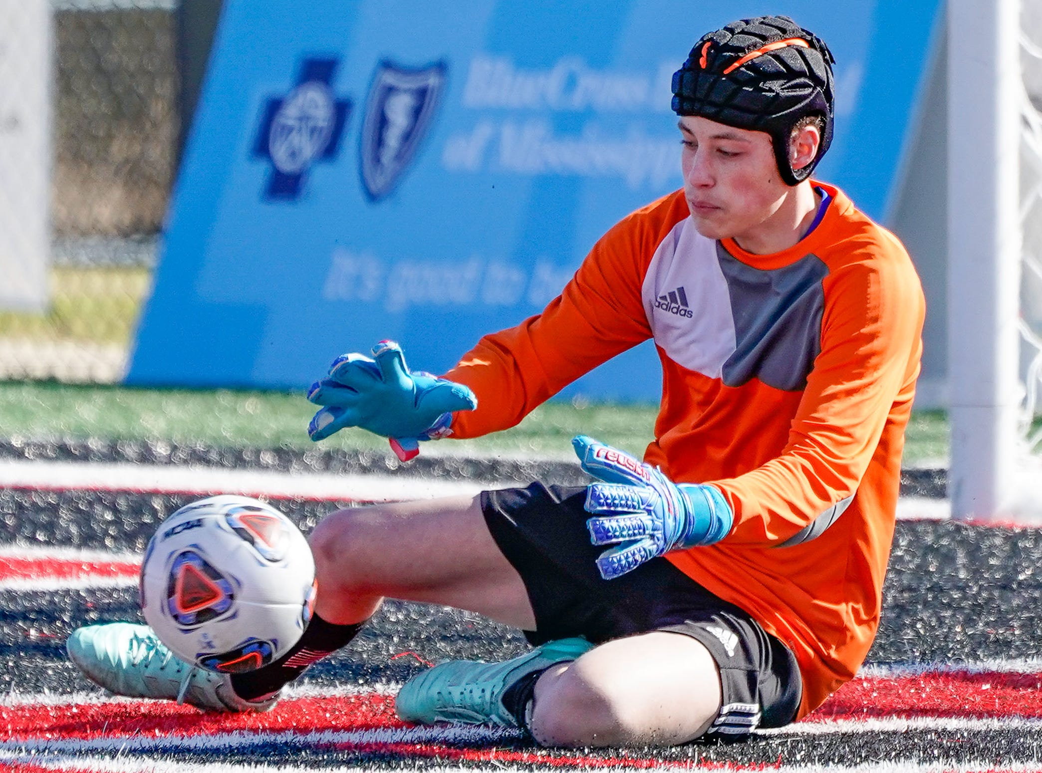 Sacred Heart keeper Jacob Painter makes a sliding save against St. Andrew's during the MHSAA 1A,2A,3A  Boys Soccer Championships held at Brandon High School in Brandon, MS, Saturday February 9, 2019.(Bob Smith-For The Clarion Ledger)