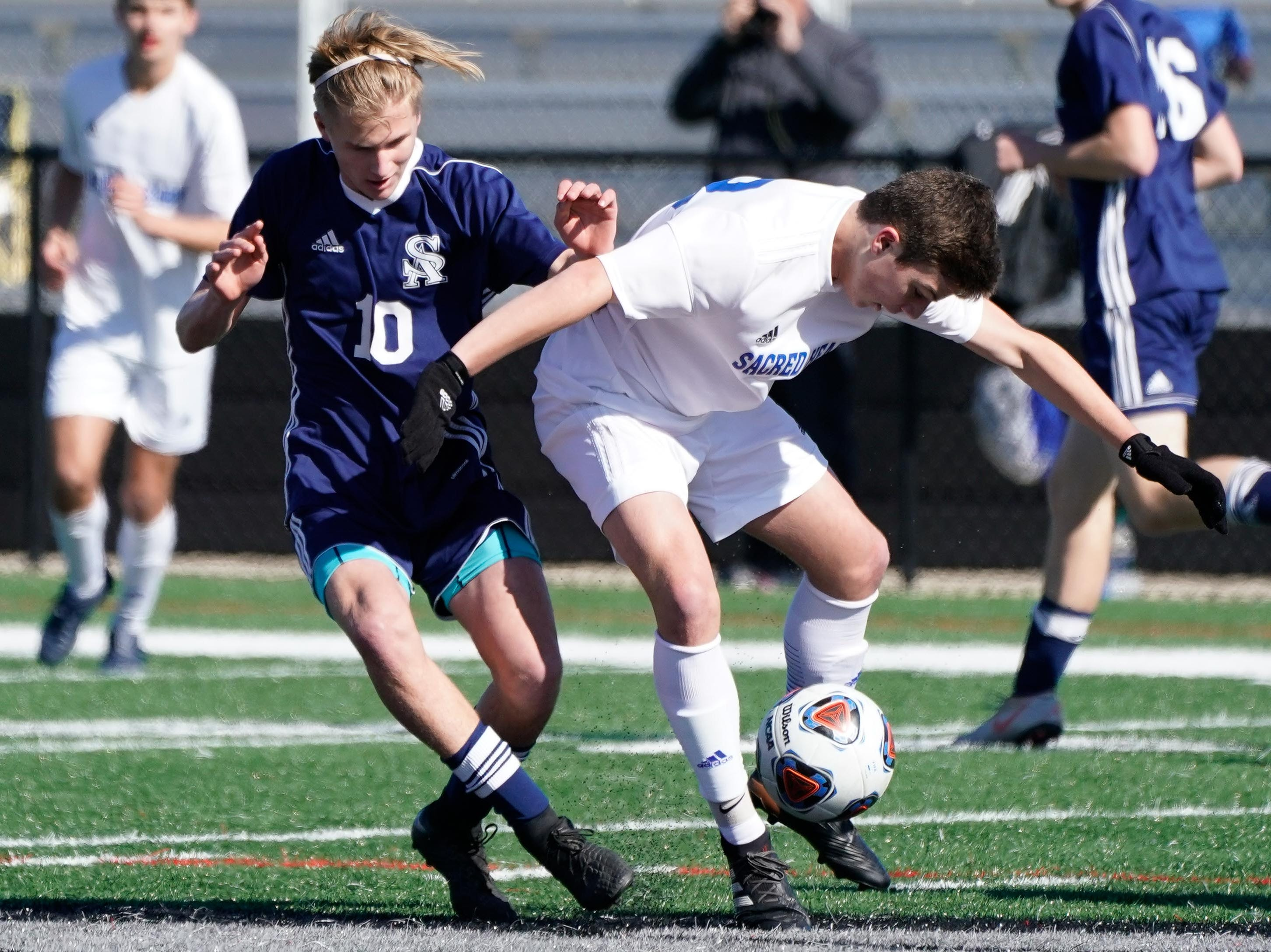 St. Andrew's Jackson Bataille (10) battles for a ball with Sacred Heart's Bennett Gibson (28) during the MHSAA 1A,2A,3A  Boys Soccer Championships held at Brandon High School in Brandon, MS, Saturday February 9, 2019.(Bob Smith-For The Clarion Ledger)