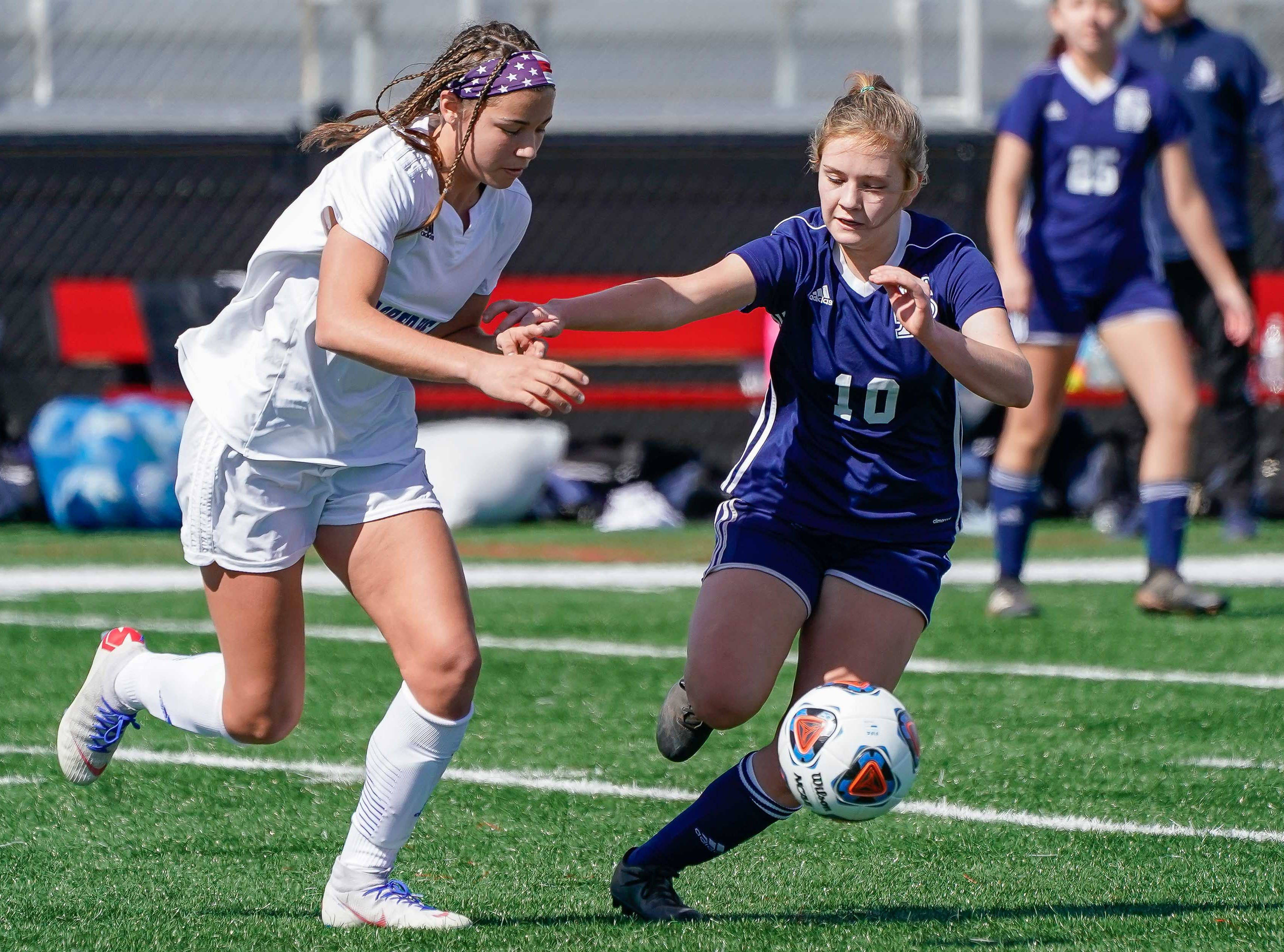 St. Andrew's Kate Rodenmeyer (10) tries to stop Sacred Heart's Graciella Falla during the MHSAA 1A,2A,3A  GIrls Soccer Championships held at Brandon High School in Brandon, MS, Saturday February 9, 2019.(Bob Smith-For The Clarion Ledger)