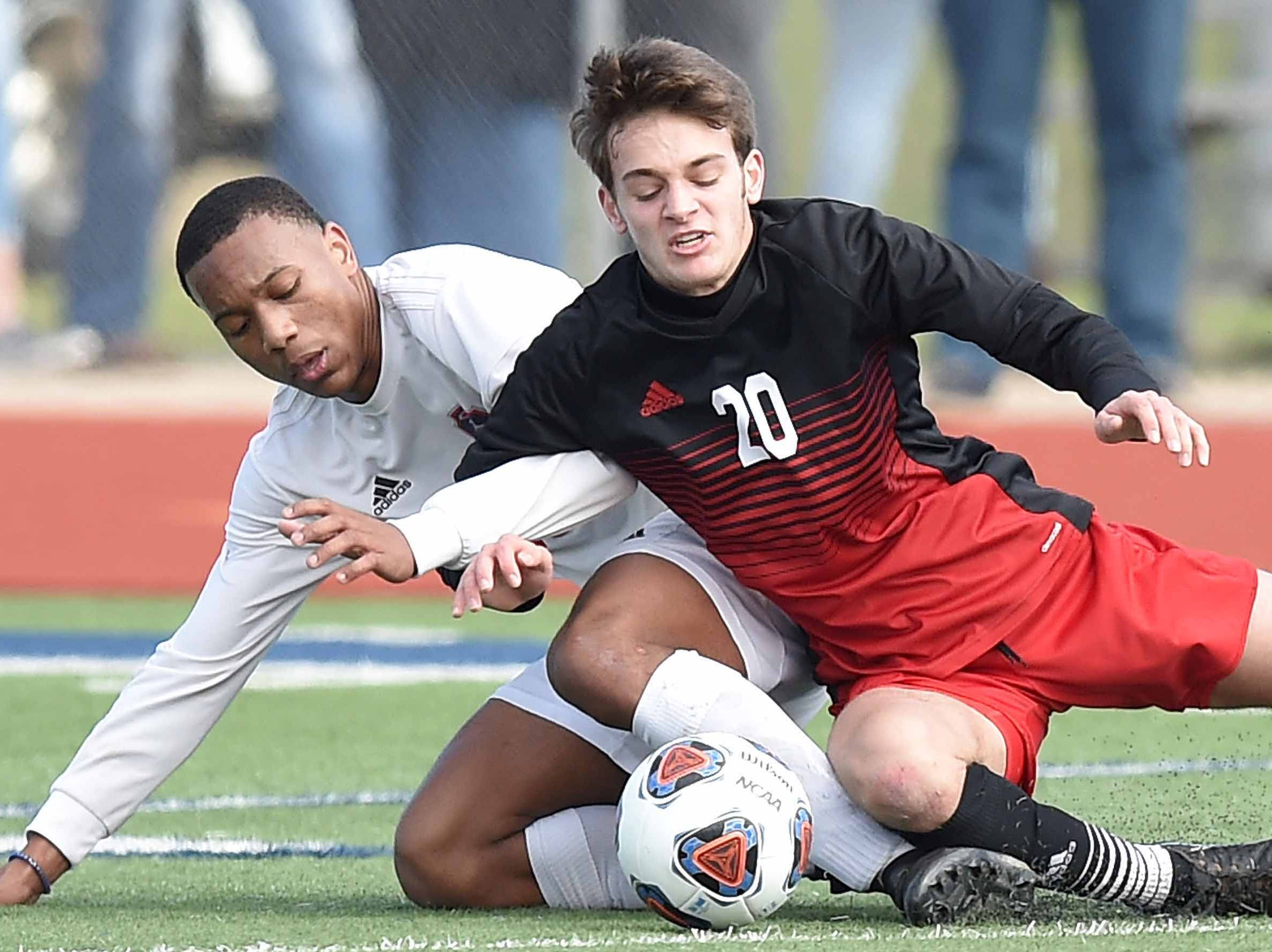 Richland's Greg Anderson (18) and West Lauderdale's Jack Green (20) go to the ground fighting for a ball in the Class 4A state championship in the MHSAA BlueCross Blue Shield of Mississippi Soccer Classic on Saturday, February 9, 2019, at Ridgeland High School in Ridgeland, Miss.
