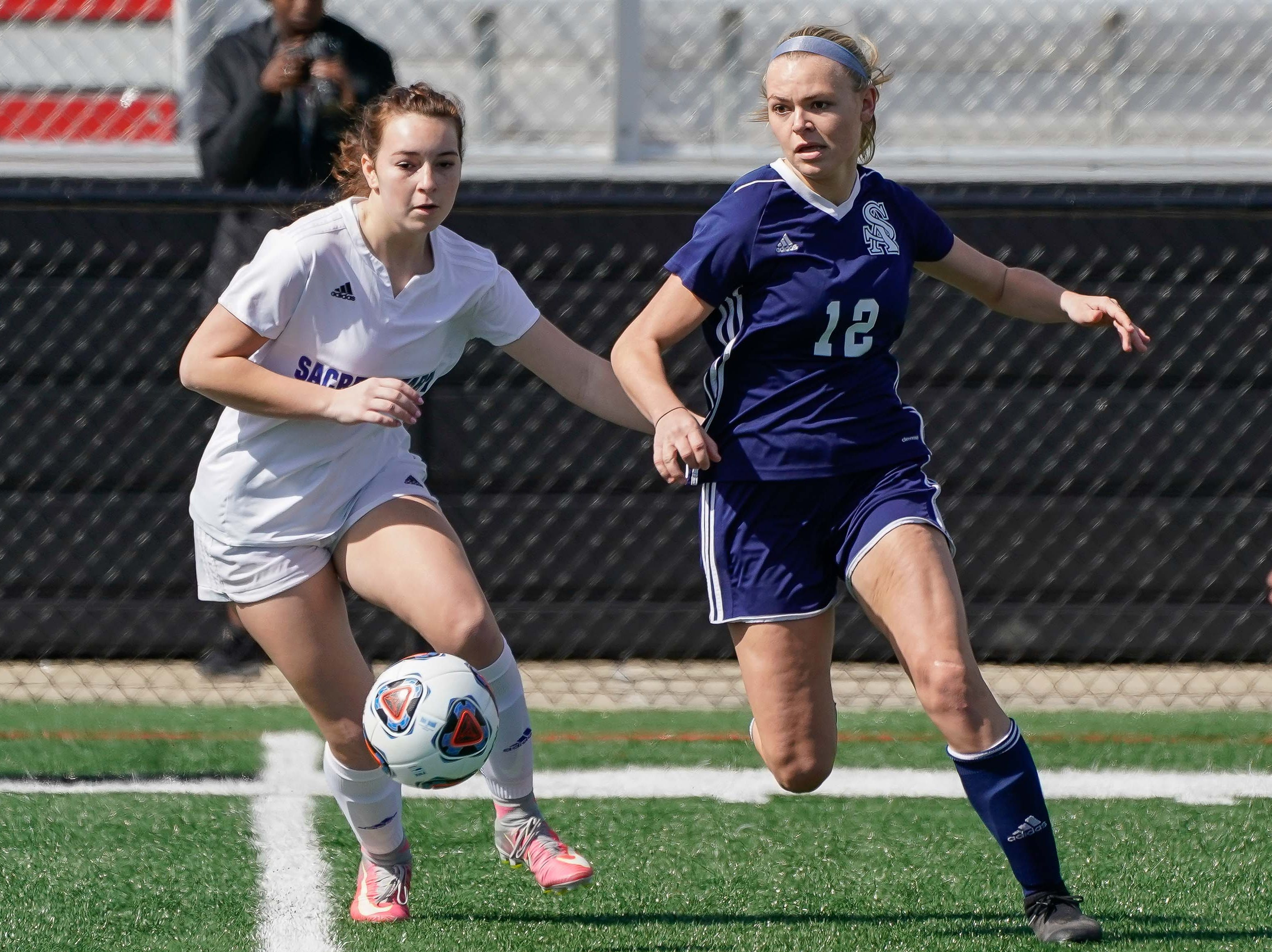 St. Andrew's Samantha Smith (12) Sacred Heart's (10) race for a ball during the MHSAA 1A,2A,3A  GIrls Soccer Championships held at Brandon High School in Brandon, MS, Saturday February 9, 2019.(Bob Smith-For The Clarion Ledger)