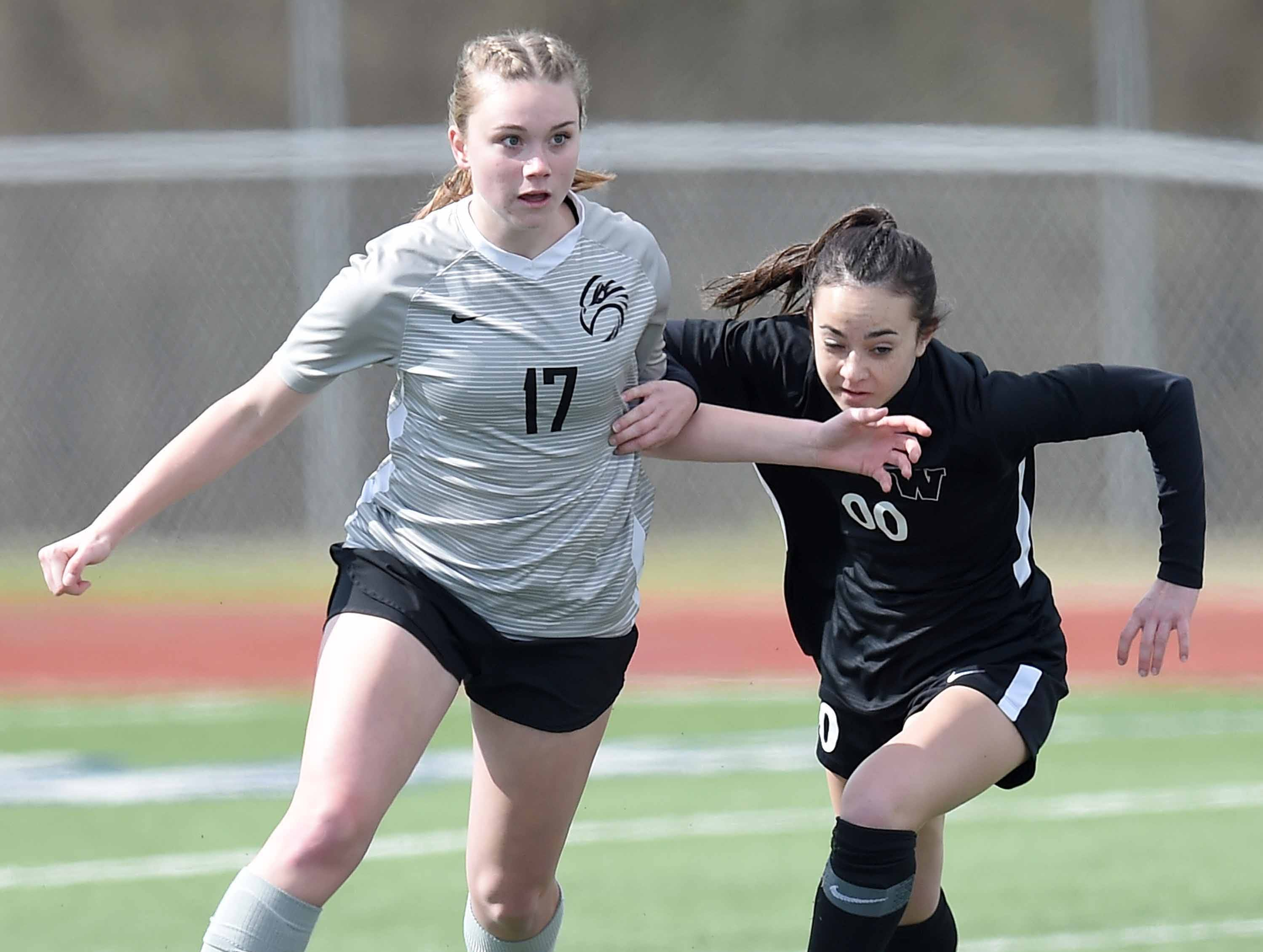 Florence's Taylor Ford (17) and West Lauderdale's Mikaela Morrison (00) compete for a ball at midfield in the Class 4A state championship in the MHSAA BlueCross Blue Shield of Mississippi Soccer Classic on Saturday, February 9, 2019, at Ridgeland High School in Ridgeland, Miss.