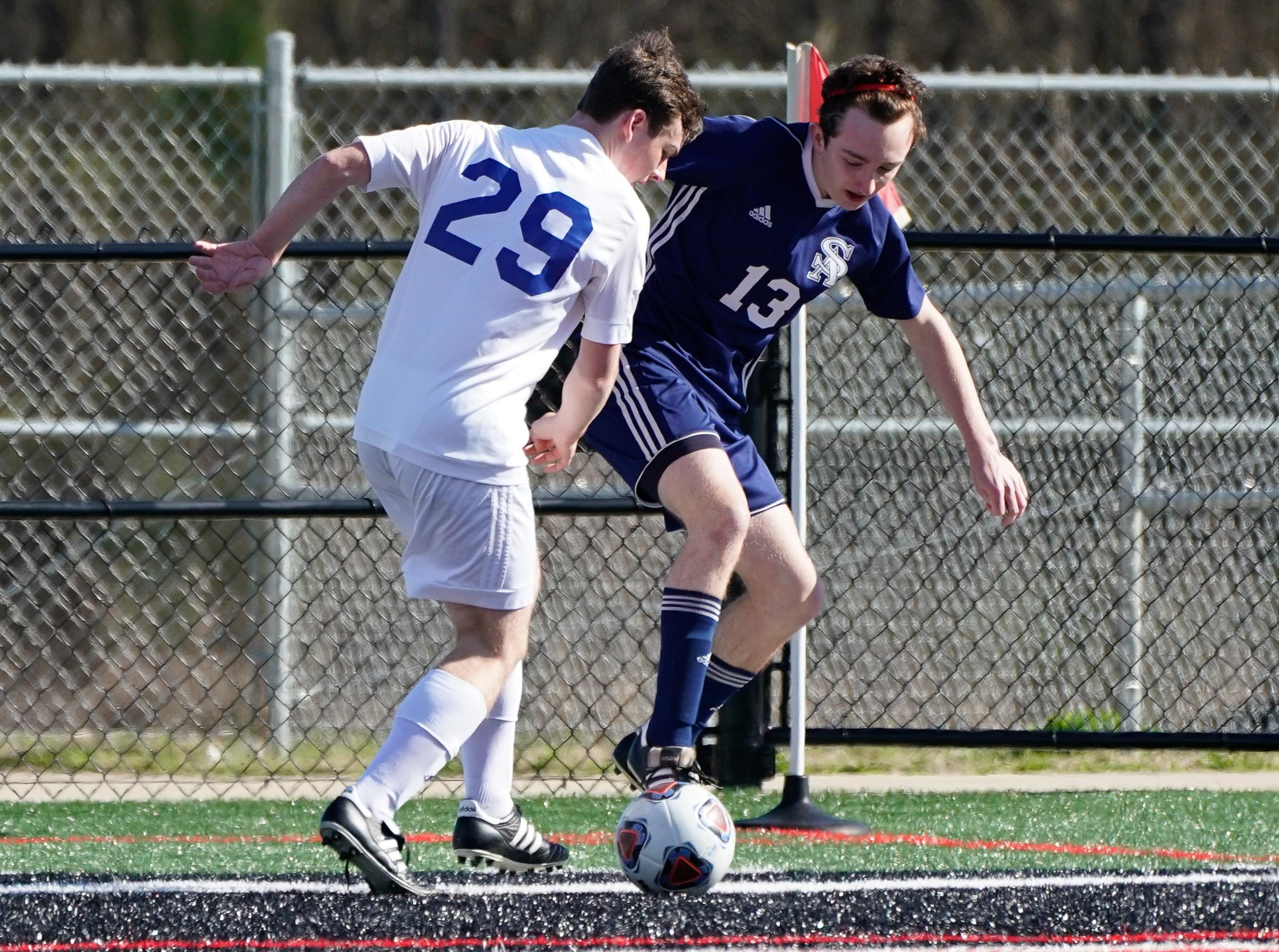 St. Andrew's John Mychal Warren (13) and Sacred Heart's Sam Magee (29) fight for a ball  during the MHSAA 1A,2A,3A  Boys Soccer Championships held at Brandon High School in Brandon, MS, Saturday February 9, 2019.(Bob Smith-For The Clarion Ledger)