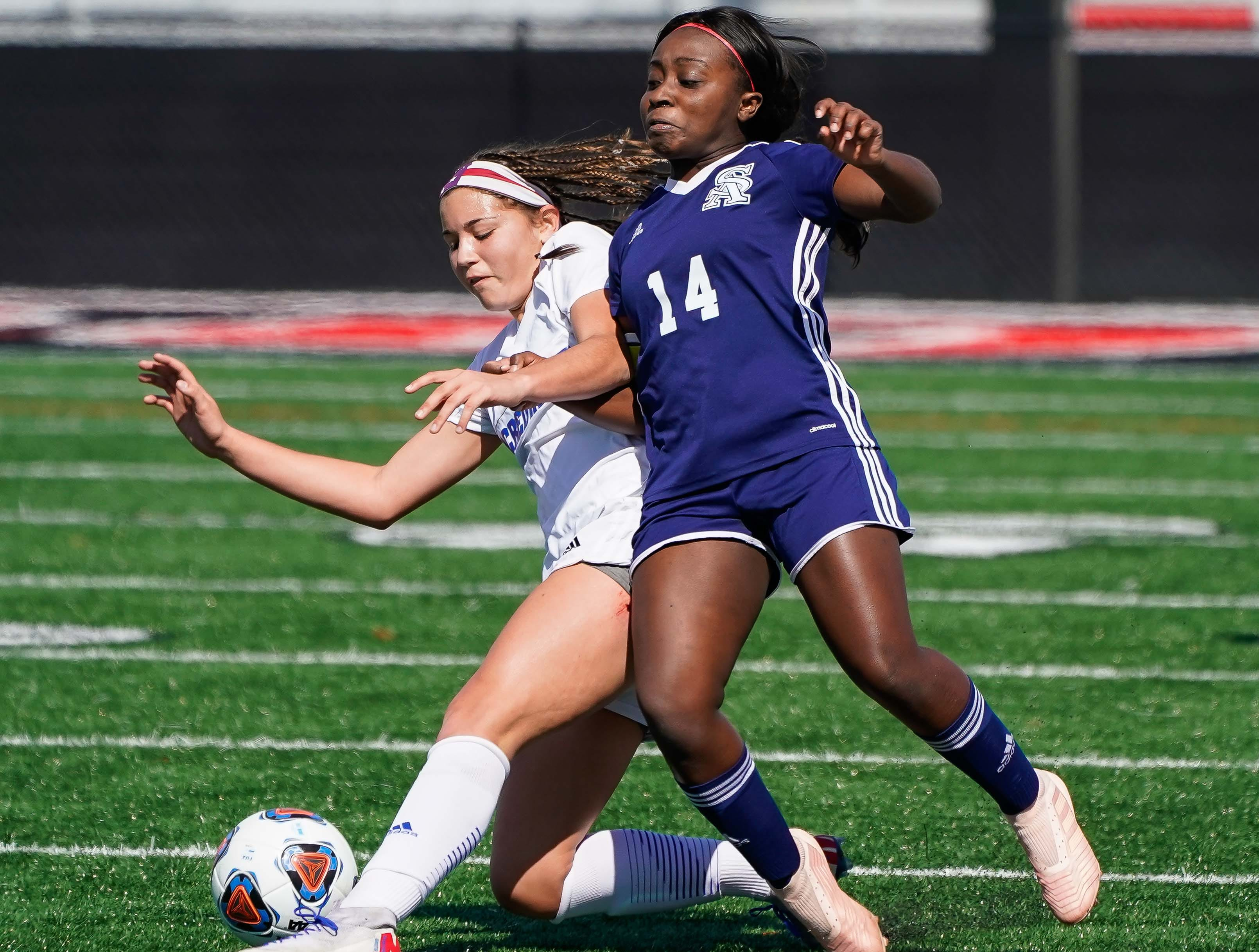 St. Andrew's Toni Oluwatade (14) tries to stop Sacred Heart's Graciella Falla (10) during the MHSAA 1A,2A,3A  GIrls Soccer Championships held at Brandon High School in Brandon, MS, Saturday February 9, 2019.(Bob Smith-For The Clarion Ledger)